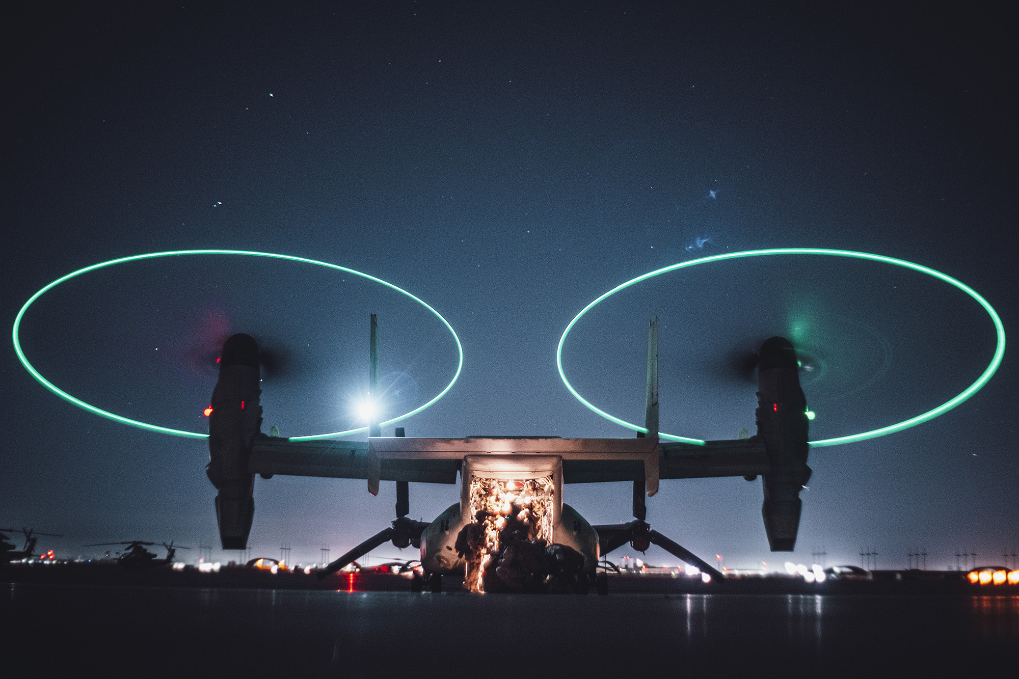 Marines with the All Domain Reconnaissance Detachment, 11th Marine Expeditionary Unit, load into an MV-22 Osprey to conduct a reconnaissance and surveillance mission insertion during a realistic urban training exercise at Marine Corps Air Station Yuma, Ariz., Feb. 19, 2020. (Staff Sgt. Donald Holbert/Marine Corps)