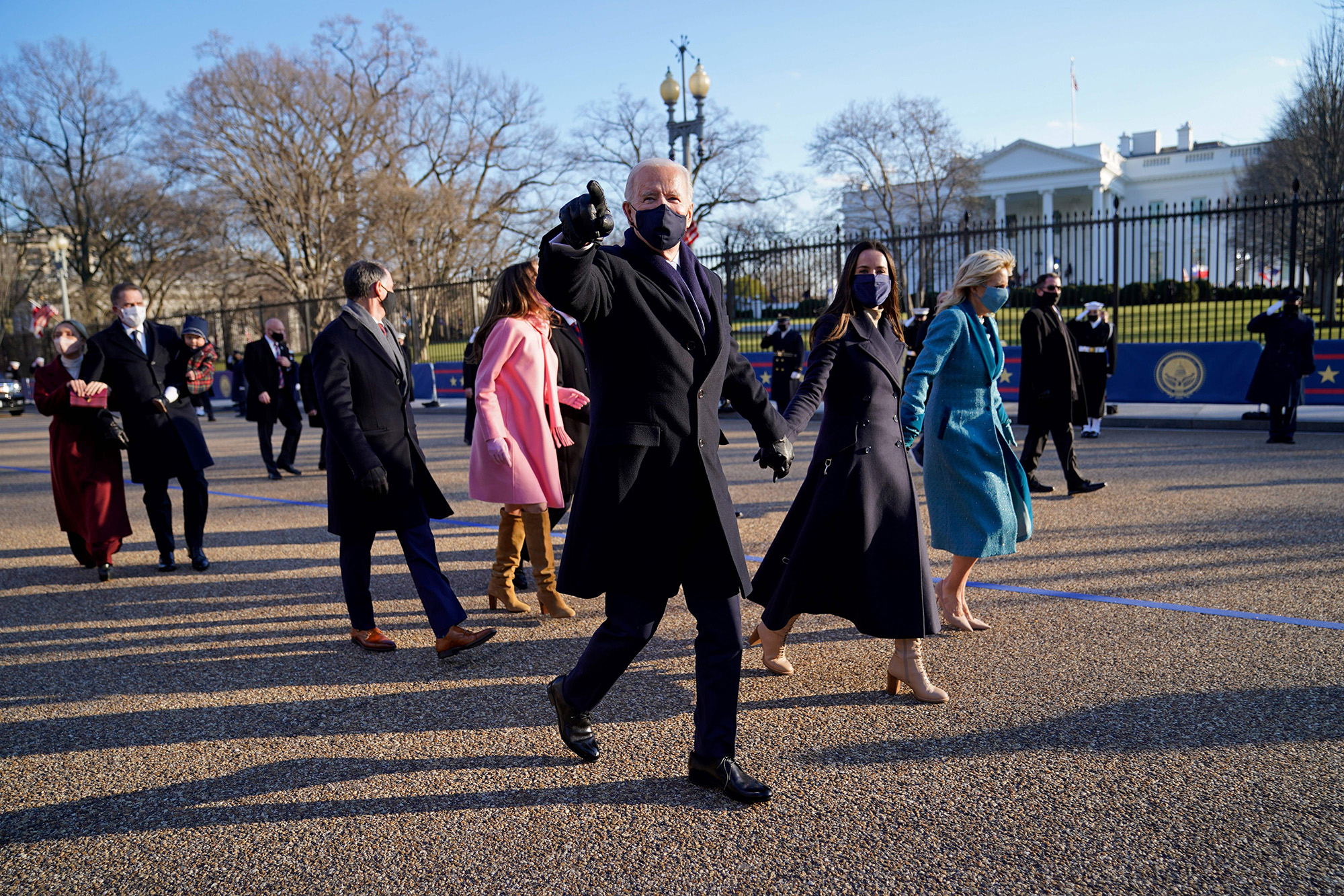 President Joe Biden and first lady Jill Biden walk up Pennsylvania Avenue towards the White House in Washington after Biden and Kamala Harris were sworn in at the Capitol on Jan. 20, 202. (Doug Mills/Pool, AFP via Getty Images)