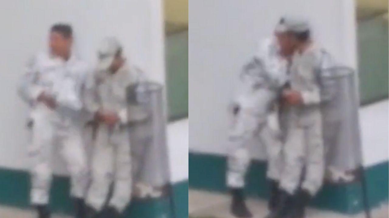 Captan a dos elementos de la Guardia Nacional dándose un beso