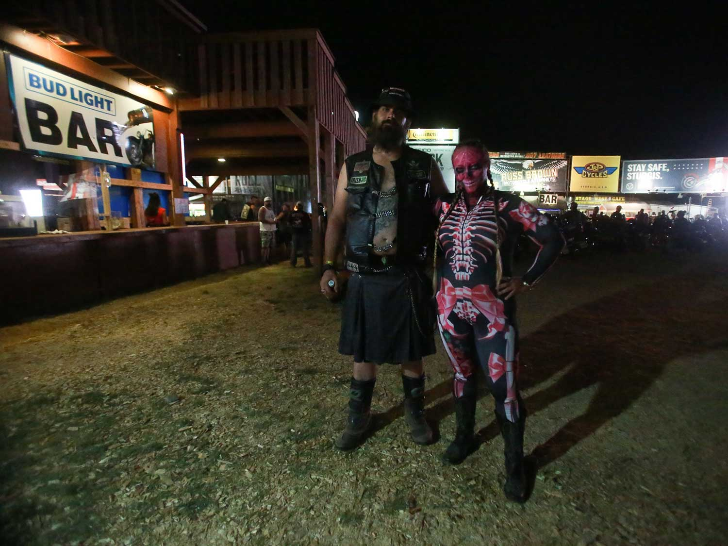 Guys in kilt and a pink skeleton bodysuit at Sturgis 2020
