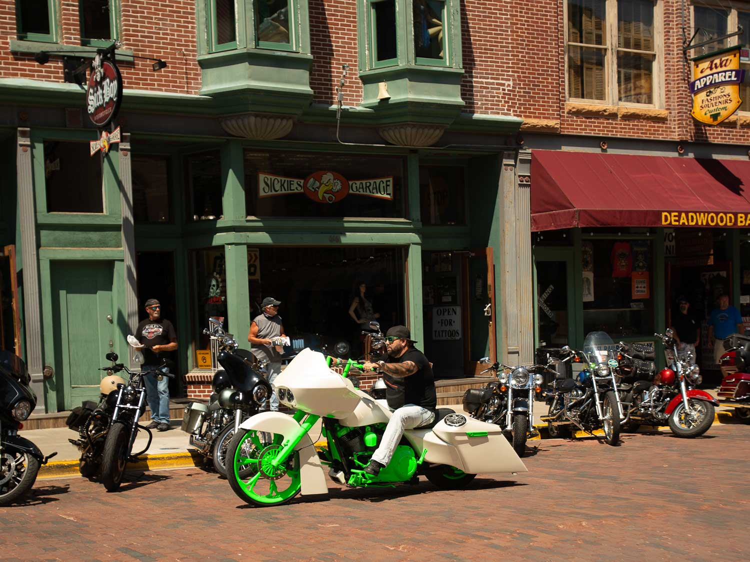 Bright white custom motorcycle with neon green accents