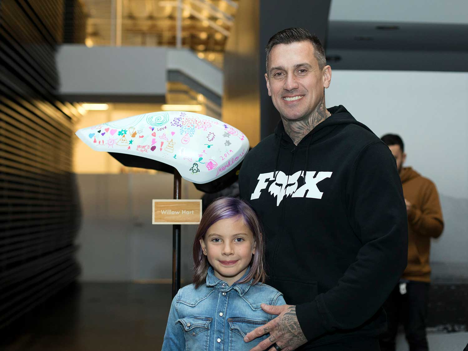 Carey Hart and his daughter, Willow, with the gas tank she painted for the auction.