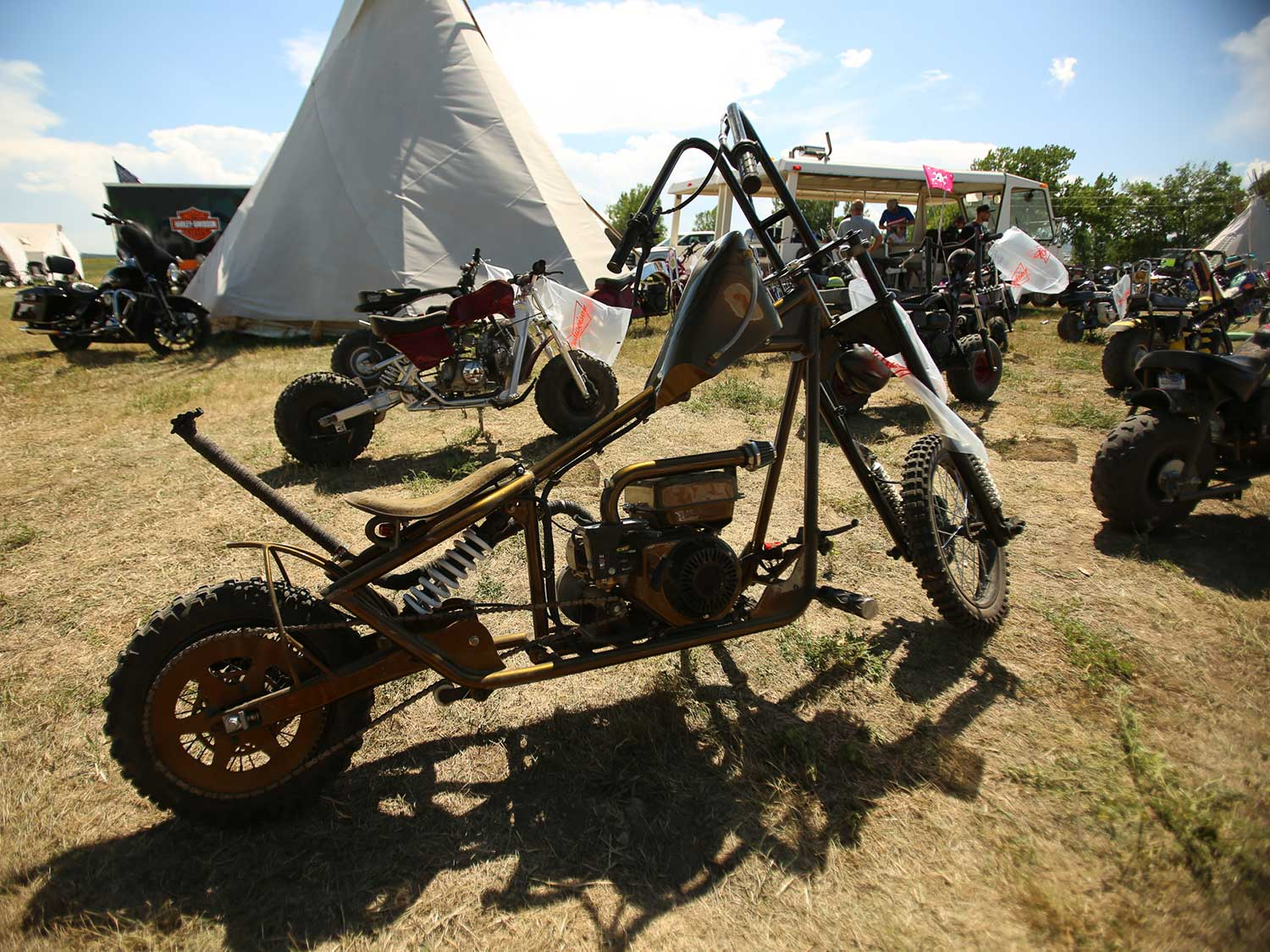 A custom pull-start chopper sits at Camp Zero