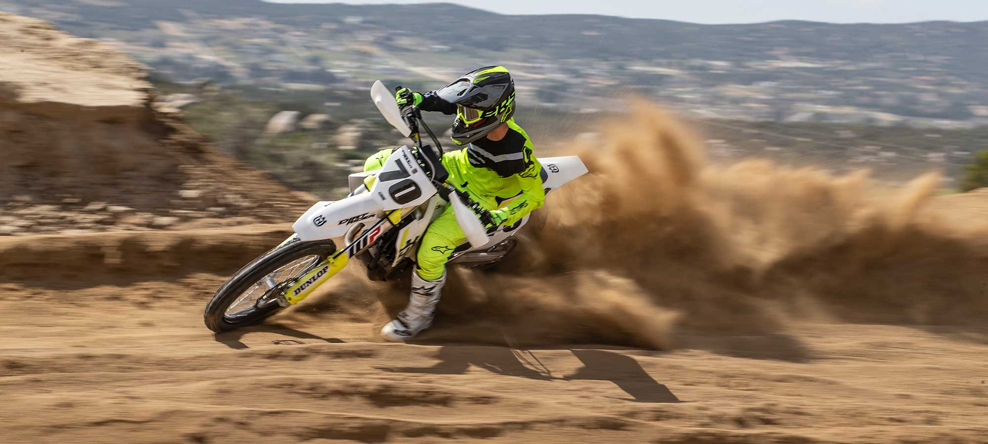 Husqvarna FX 450 riding on sand.