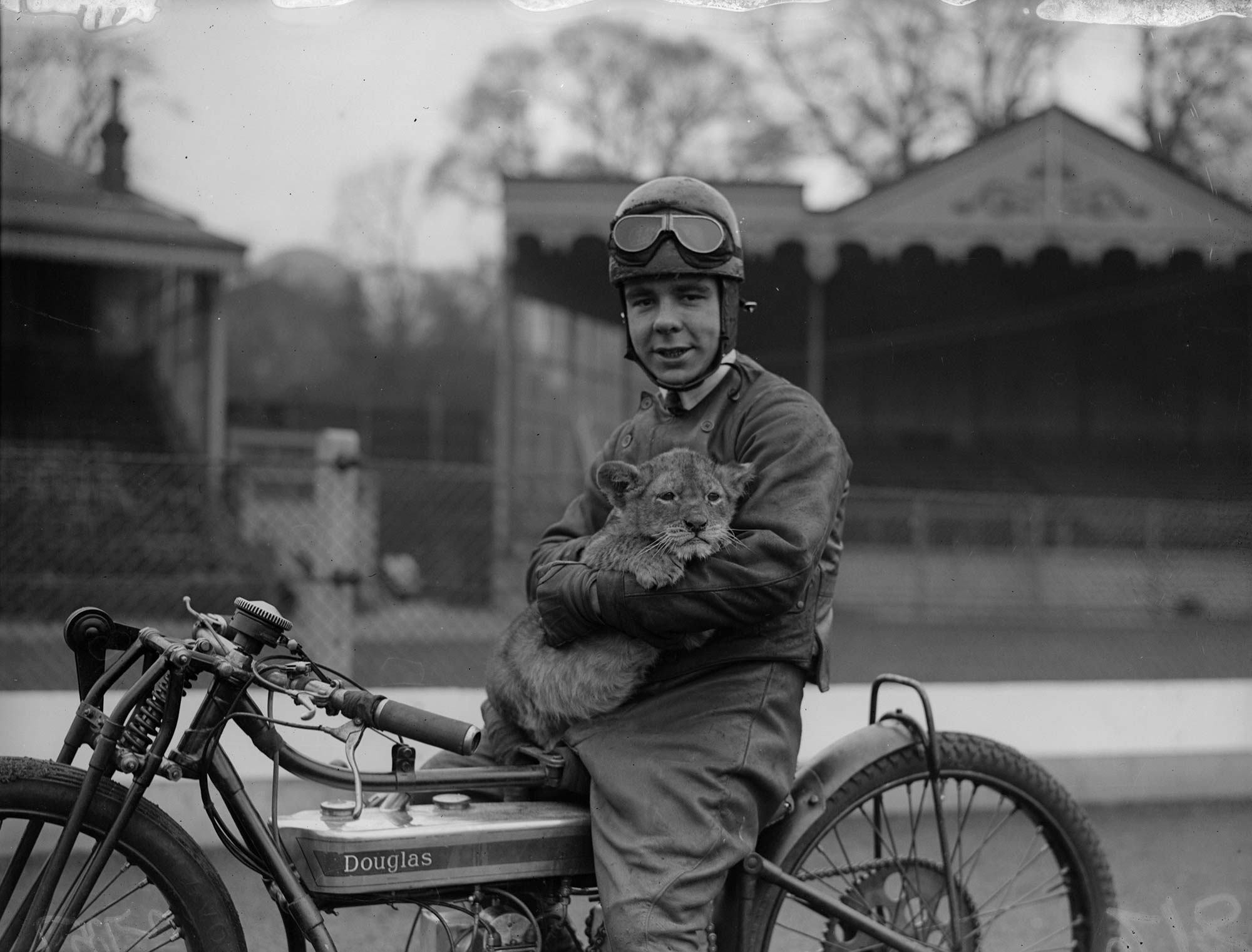 Back in 1930, rider Triss Sharp would take his pet lion cub along on his motorcycle!