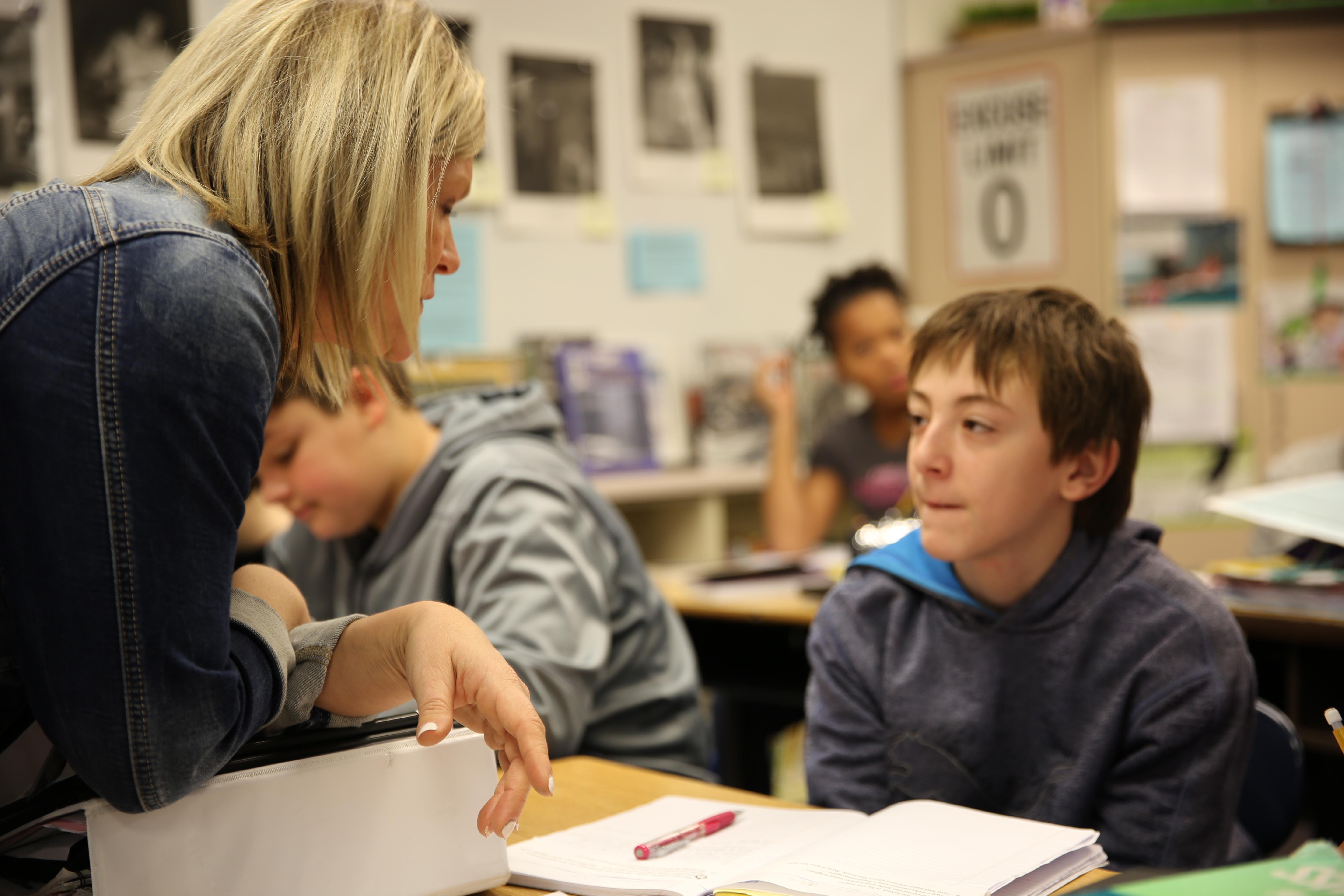 Class Of 2025 student Ethan listens to his writing teacher, Ashley Wilson, in November 2018 at a Beaverton middle school.