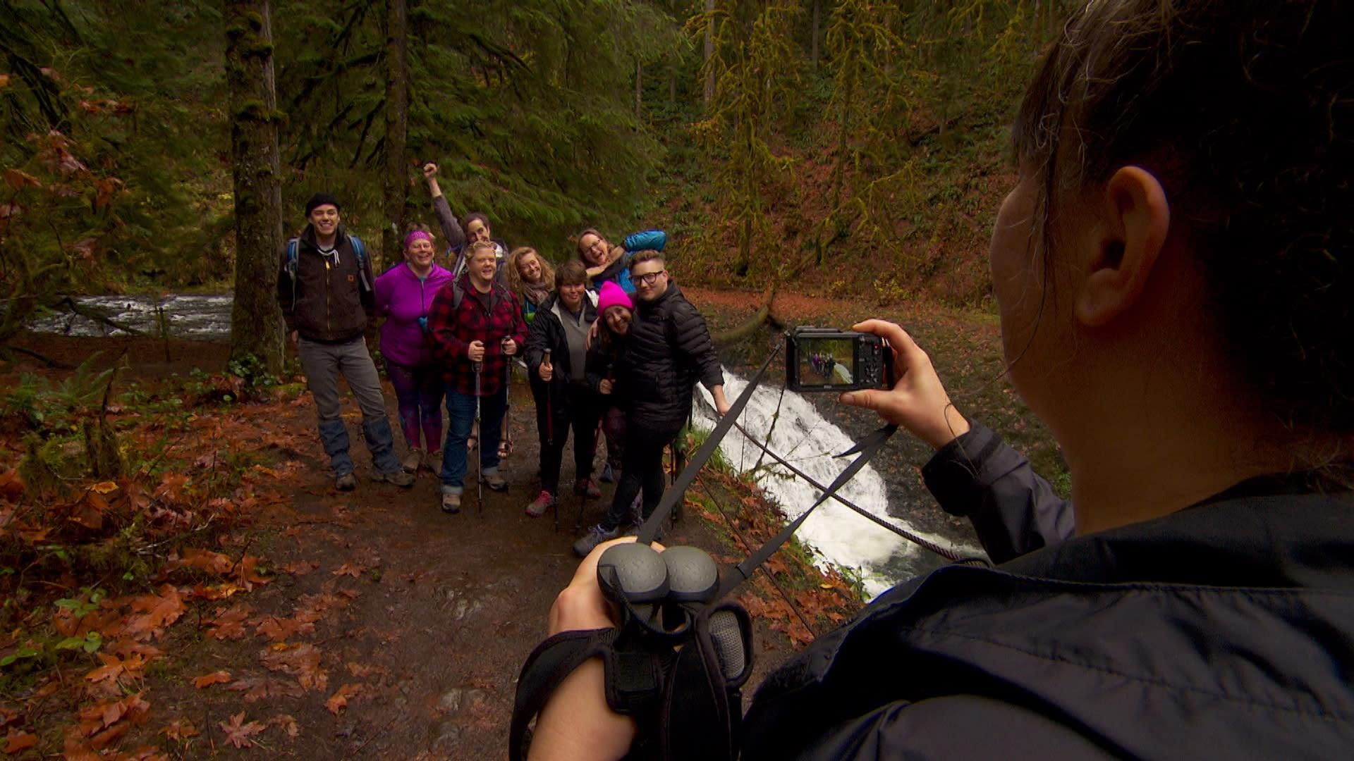 Jenny Bruso snaps a photo during an Unlikely Hikers group hike at Silver Falls State Park.