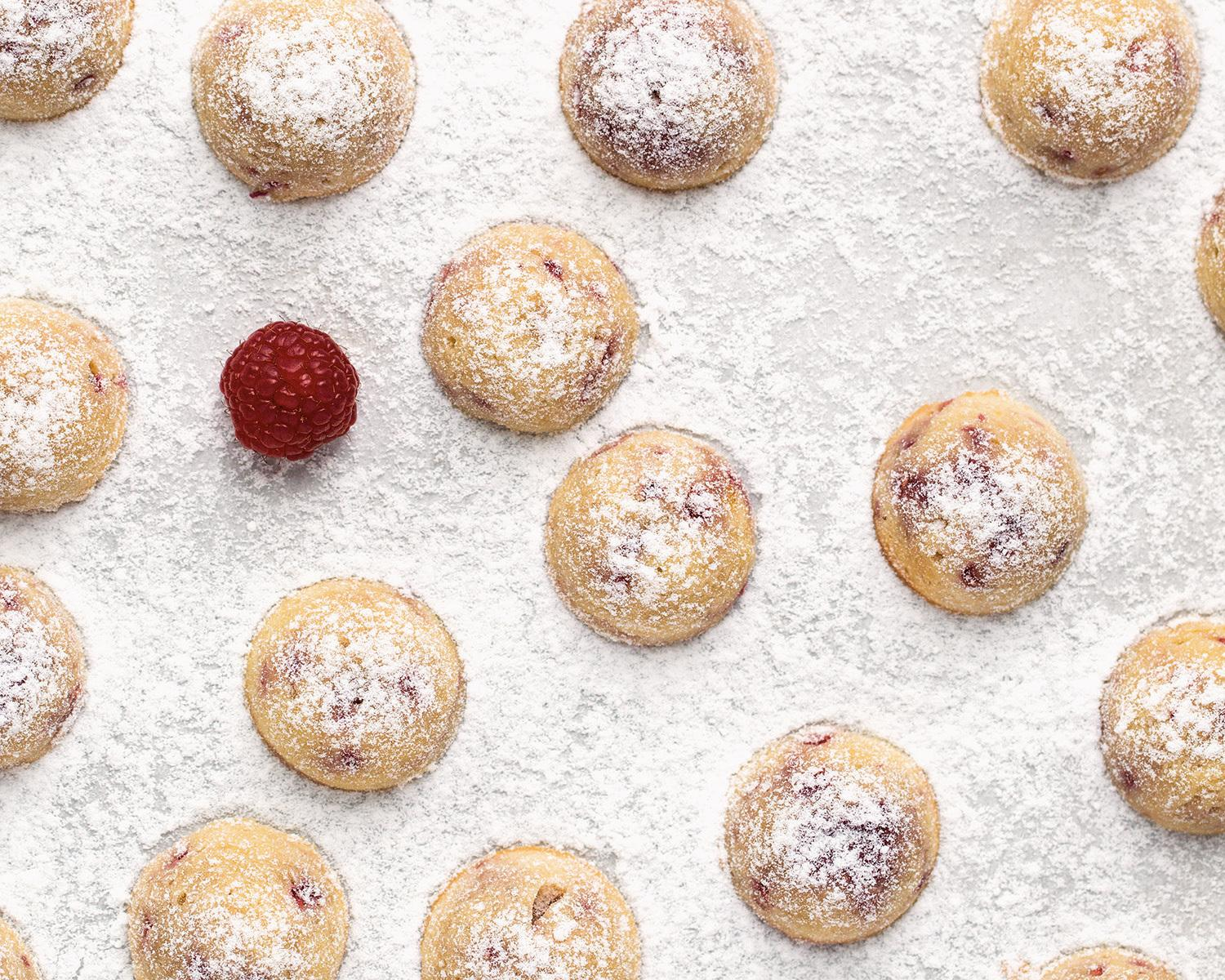 """These Raspberry Almond Tea Cakes from """"Modern French Pastry"""" are """"easy"""" (earning only one-half macaron out of three) and can be filled with frozen berries out of season."""