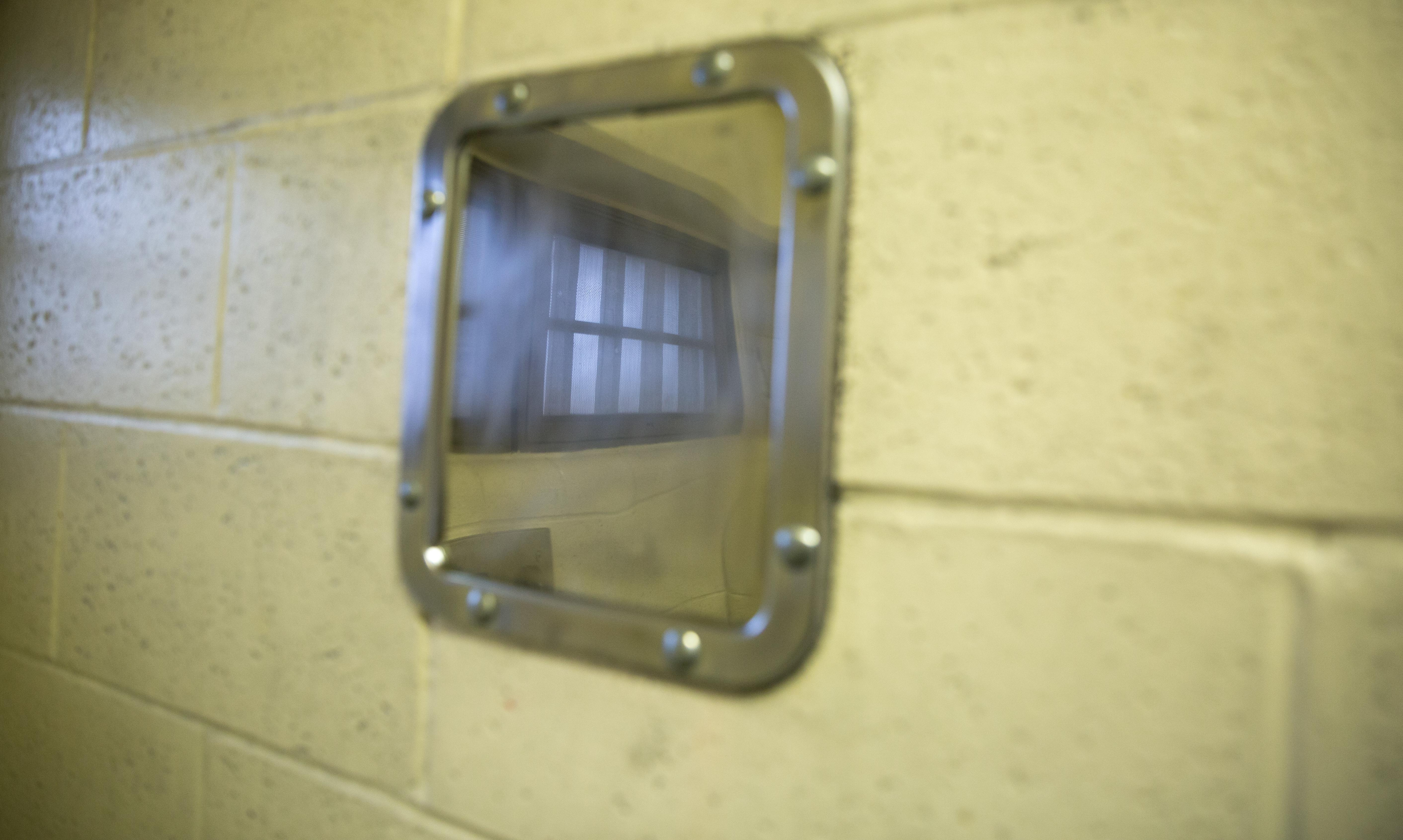 The reflection of a jail cell window is visible in this stainless steel mirror in a Clark County Jail cell in Vancouver, Wash., on March 14, 2019. The mirror is made out of a solid sheet of metal instead of glass.