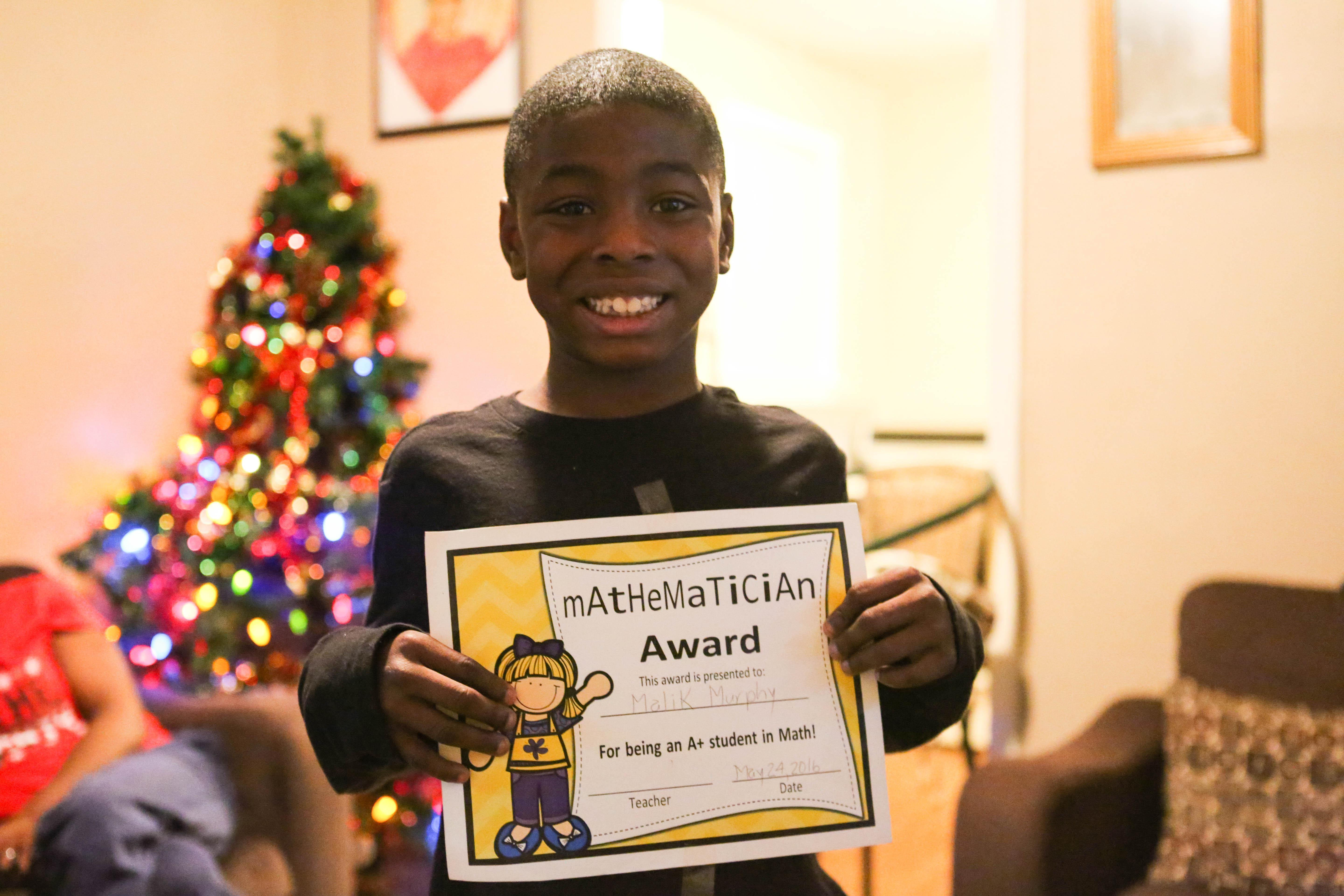 Malik Murphy, a 9-year-old in Memphis, Tennessee, is doing well in school now, after working with Cayla Beard, of Youth Villages.