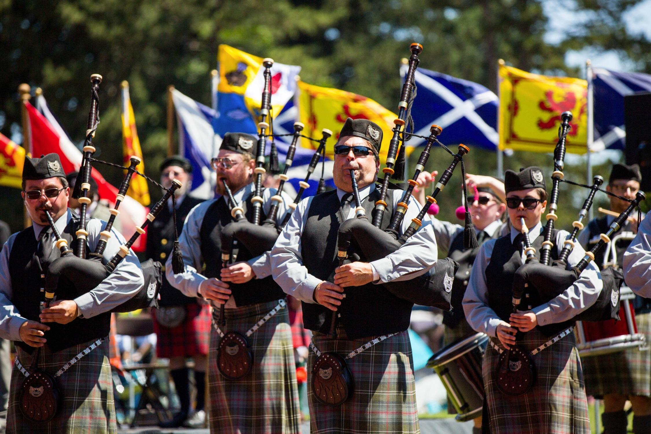 Bagpipers play the Welcome Ceremony at the Portland Highland Games in Gresham, Oregon, Saturday, July 15, 2017.