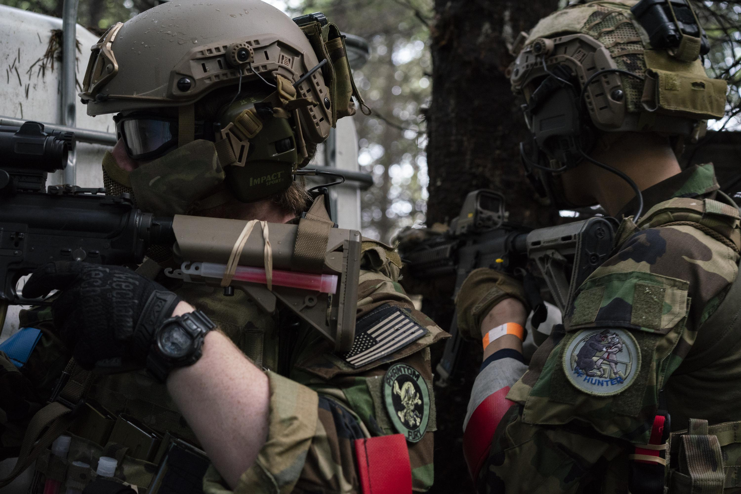 Noah Wenger and Alex Bates look for opponents during an AirSoft game at Action Acres AirSoft on March 23, 2019, in Canby, Ore.