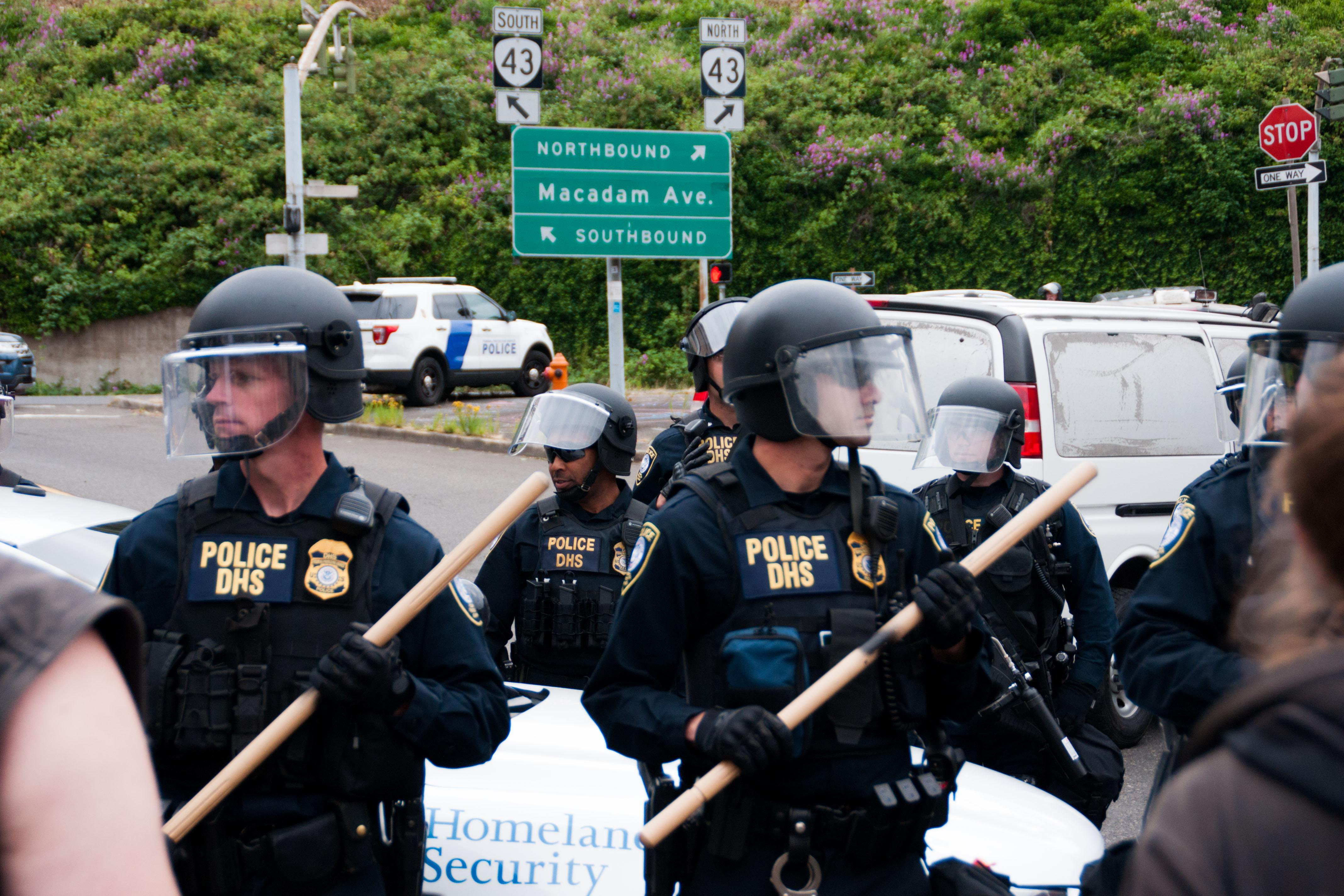 Federal law enforcement officers hold a police line at the Portland ICE building on SW Macadam Avenue Thursday, June 28, 2018, after officials worked to clear the entrance to the building.