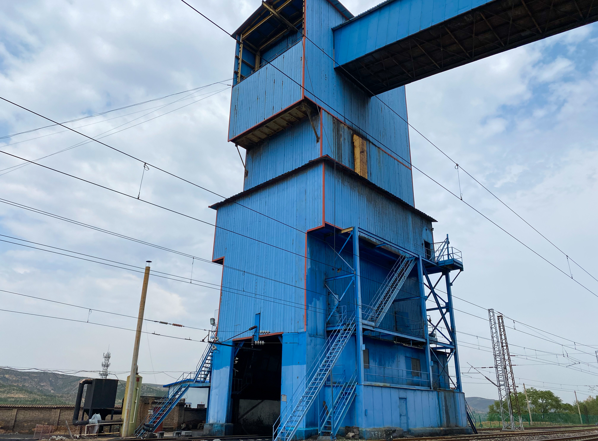 An industrial-looking building that has been painted blue.