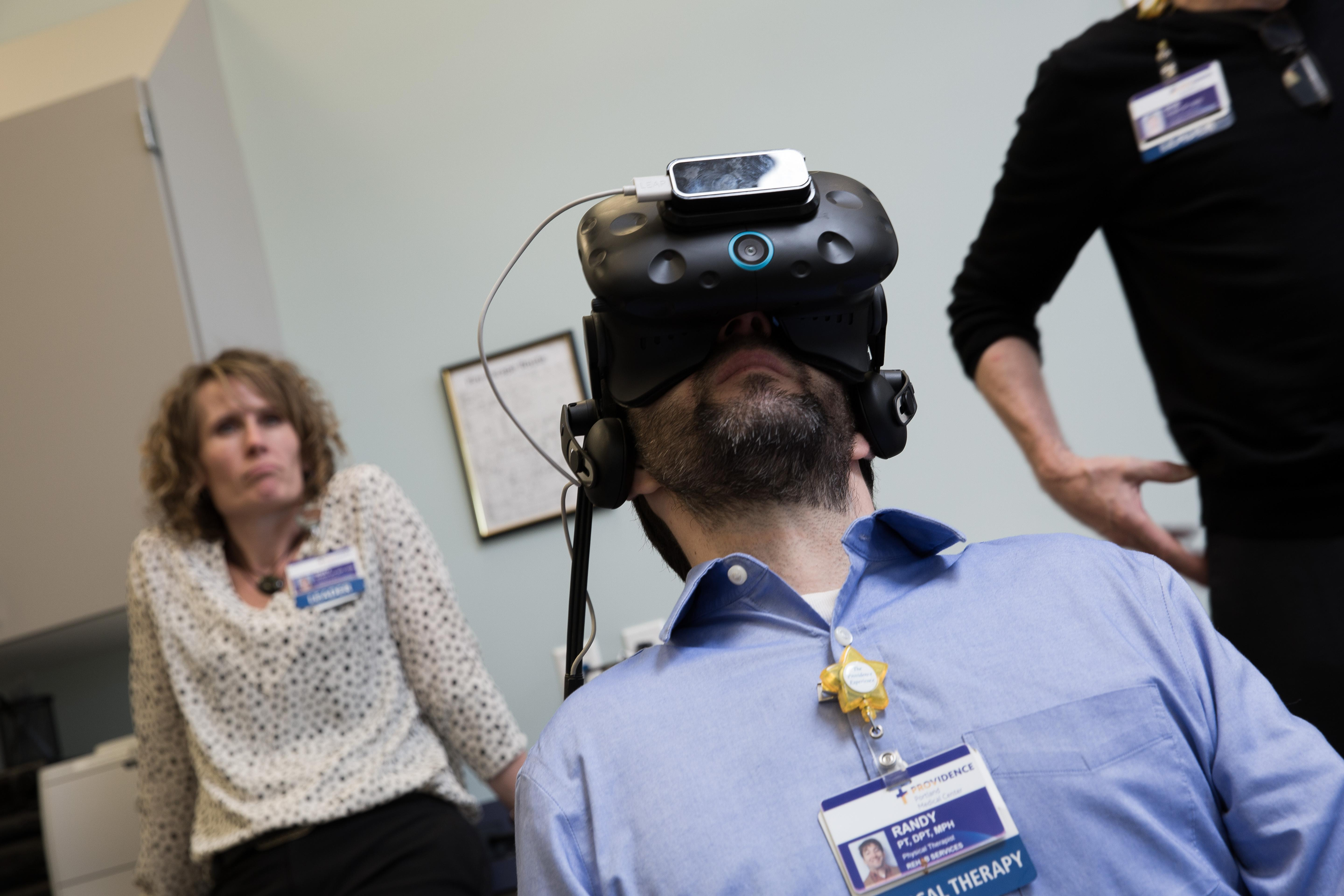 Physical therapist Randy Rodriguez participated in a VR for pain management demo at Providence Gresham Rehab and Sports Therapy clinic.