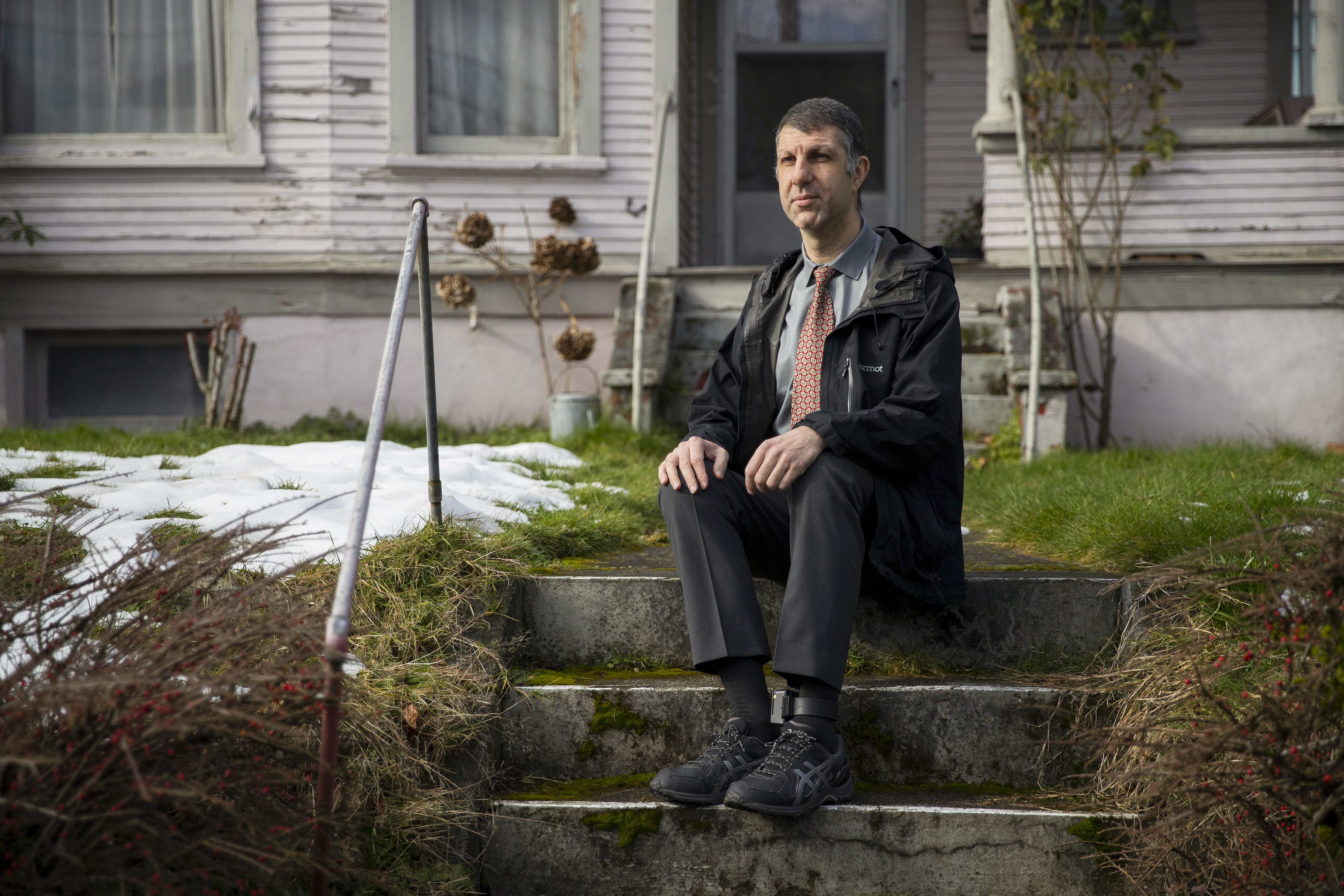 Joe Dibee is portrayed while sitting on steps leading to his family's home on Wednesday, February 17, 2021, in Seattle. KUOW Photo/Megan Farmer