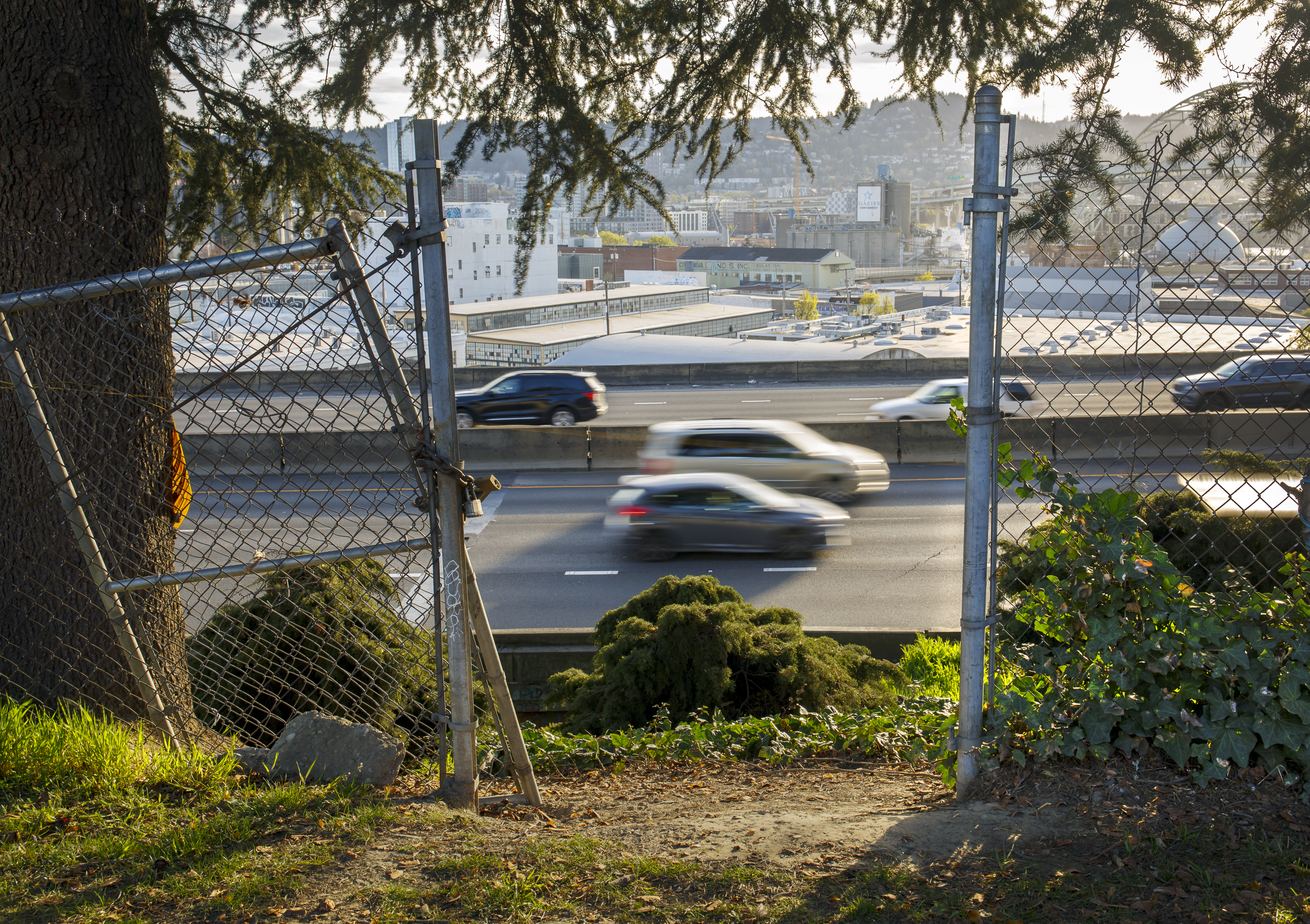 The I-5 freeway is seen through the fencing at the back of Harriet Tubman Middle School in North Portland, April 9, 2021. ODOT's proposed Rose Quarter expansion would bring the freeway even closer to the school grounds.