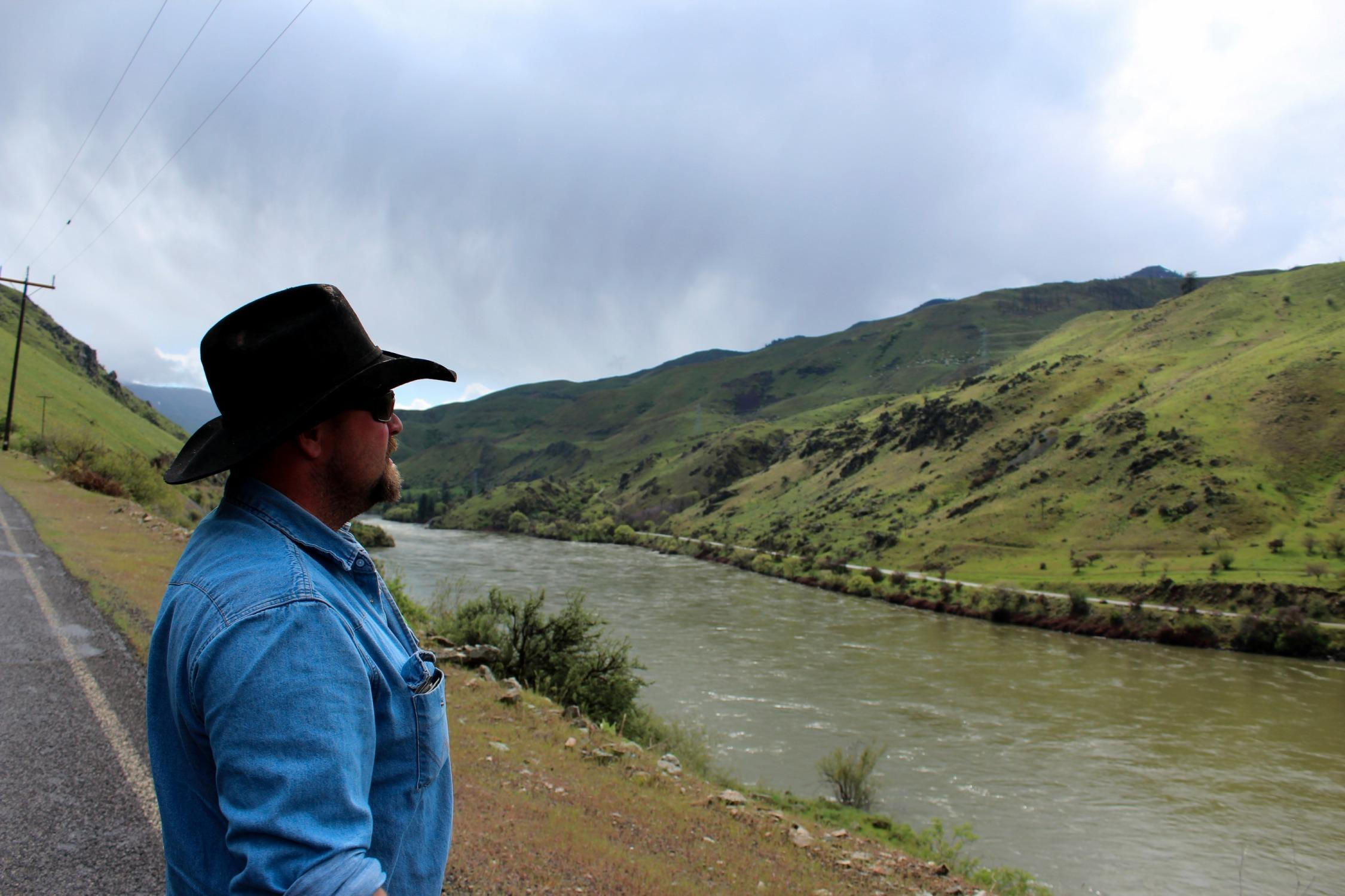 Rancher Chad DelCurto stands at the banks of the Snake River, surveying the stretch of public land where his cattle graze. DelCurto said he lost 41 calves and 11 cows last year, and he blames wolves.