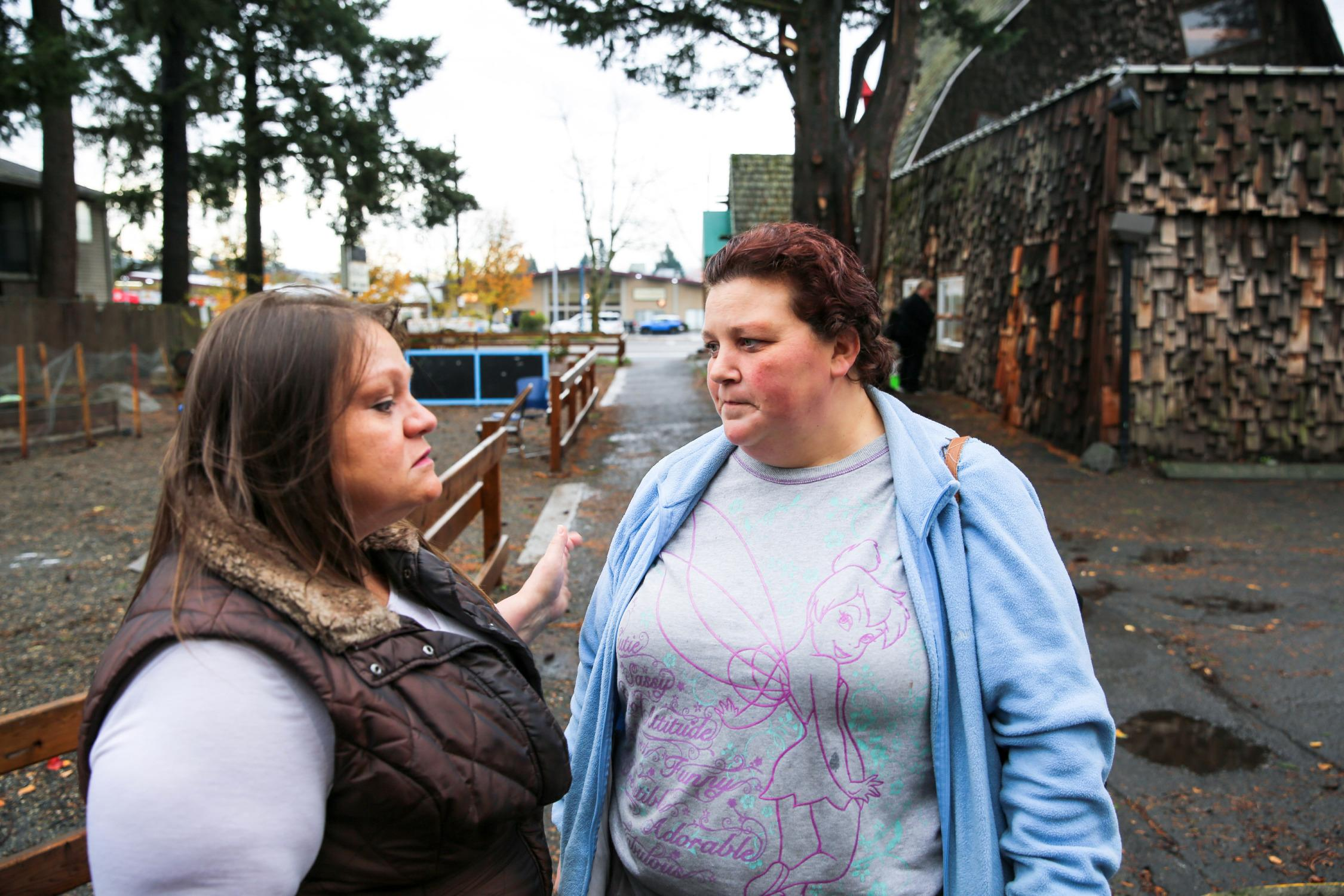 Staffer Gissel Gonzalez and Andrea Bunch at the family shelter, on Portland's Stark Street.
