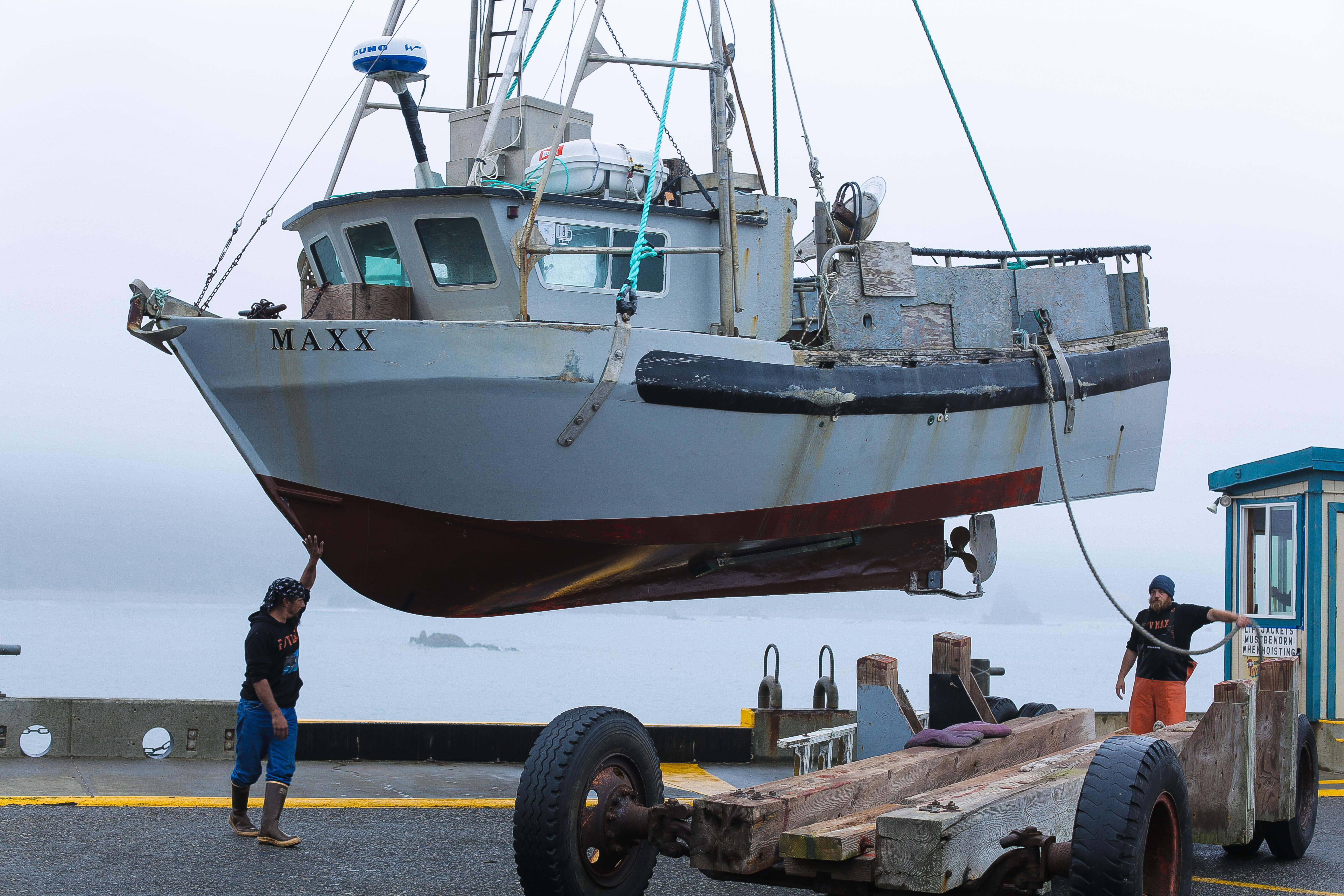 """The fishing vessel """"Maxx"""" is hoisted by crane onto the port of Port Orford's dry dock, May 13, 2018."""