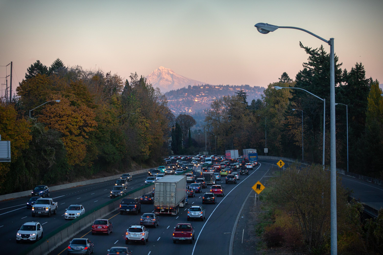 Cars travel along Interstate 5 through Portland, Ore., Friday, Nov. 1, 2019.
