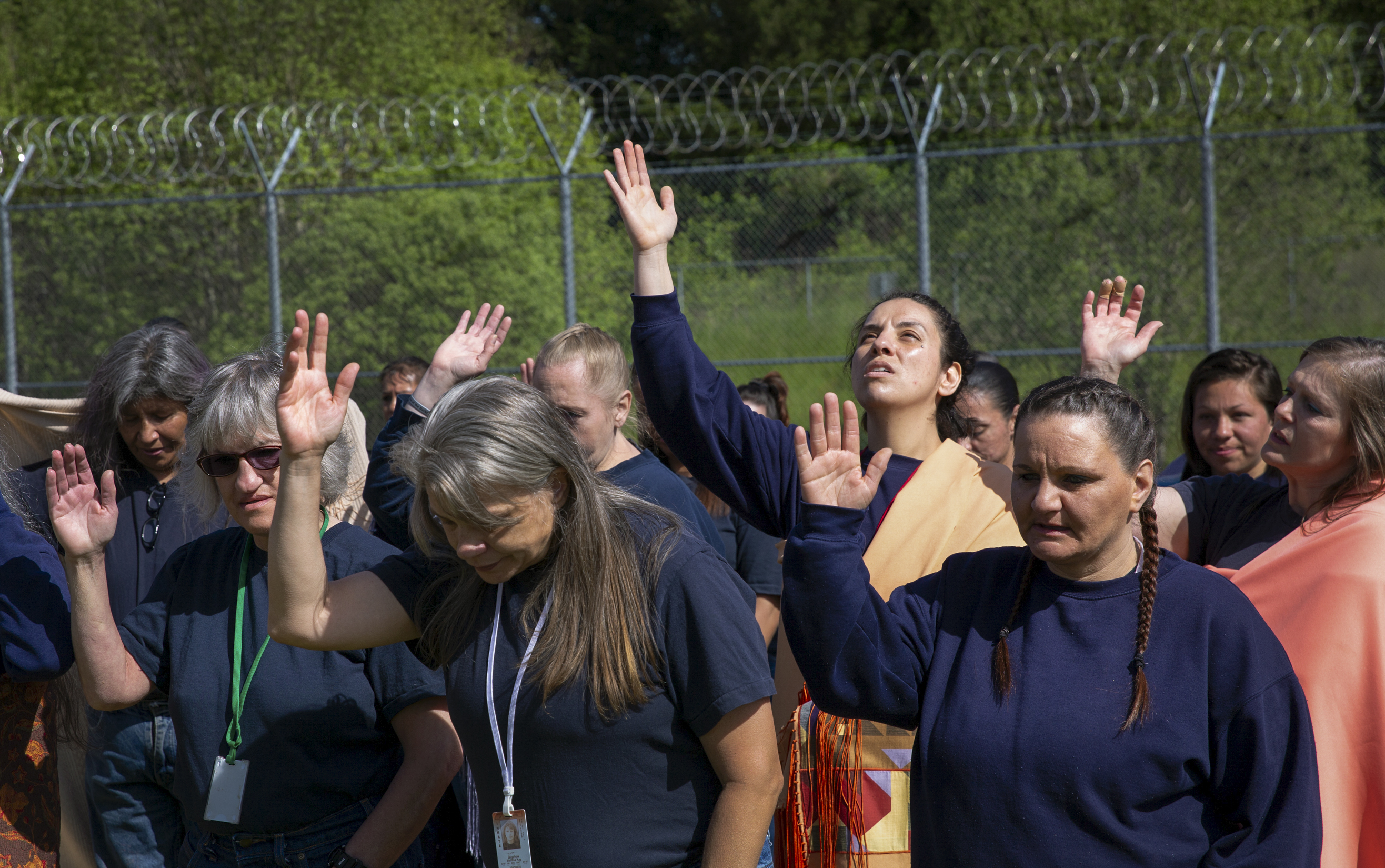 Women pray during a spring celebration and first foods blessing at Coffee Creek Correctional Institute in Wilsonville, Ore., May 4, 2019. The annual event brings Indigenous women at the prison together with tribal elders and volunteers.