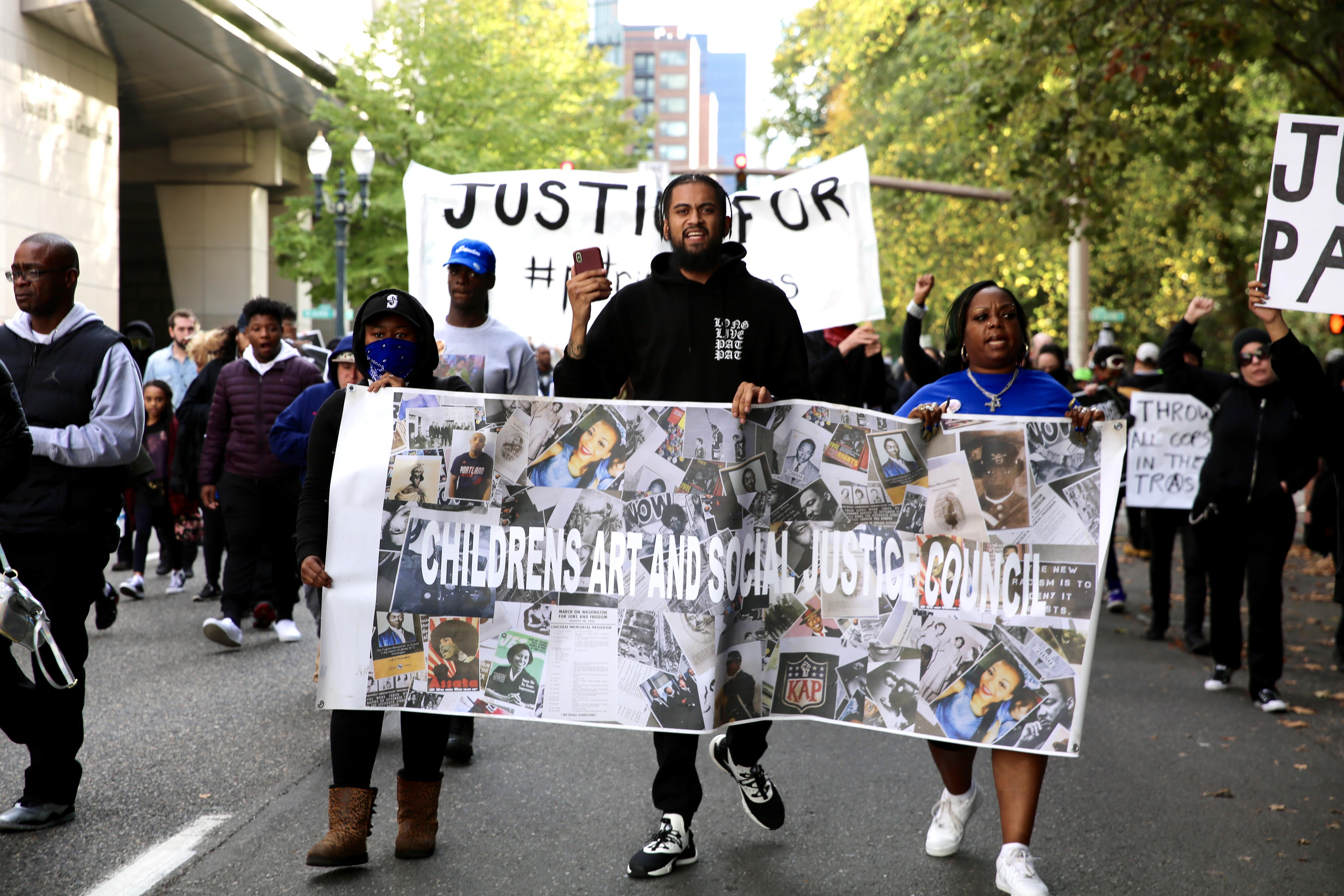 The family of Patrick Kimmons march through downtown Portland Saturday Oct. 6.