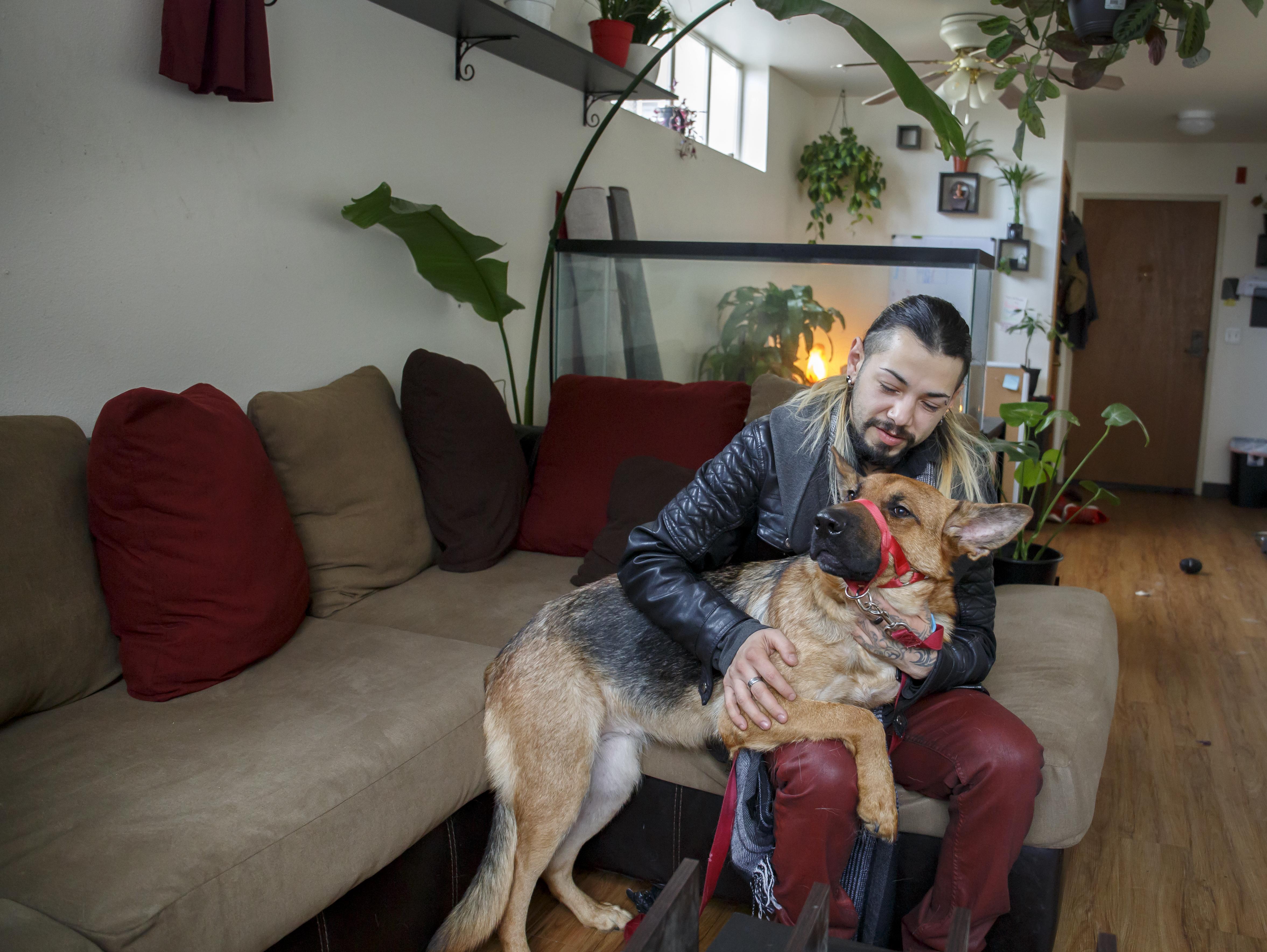 Leonardo Cruz and his emotional support dog, Aurora, at their home in Portland, Friday, Jan. 22, 2021.