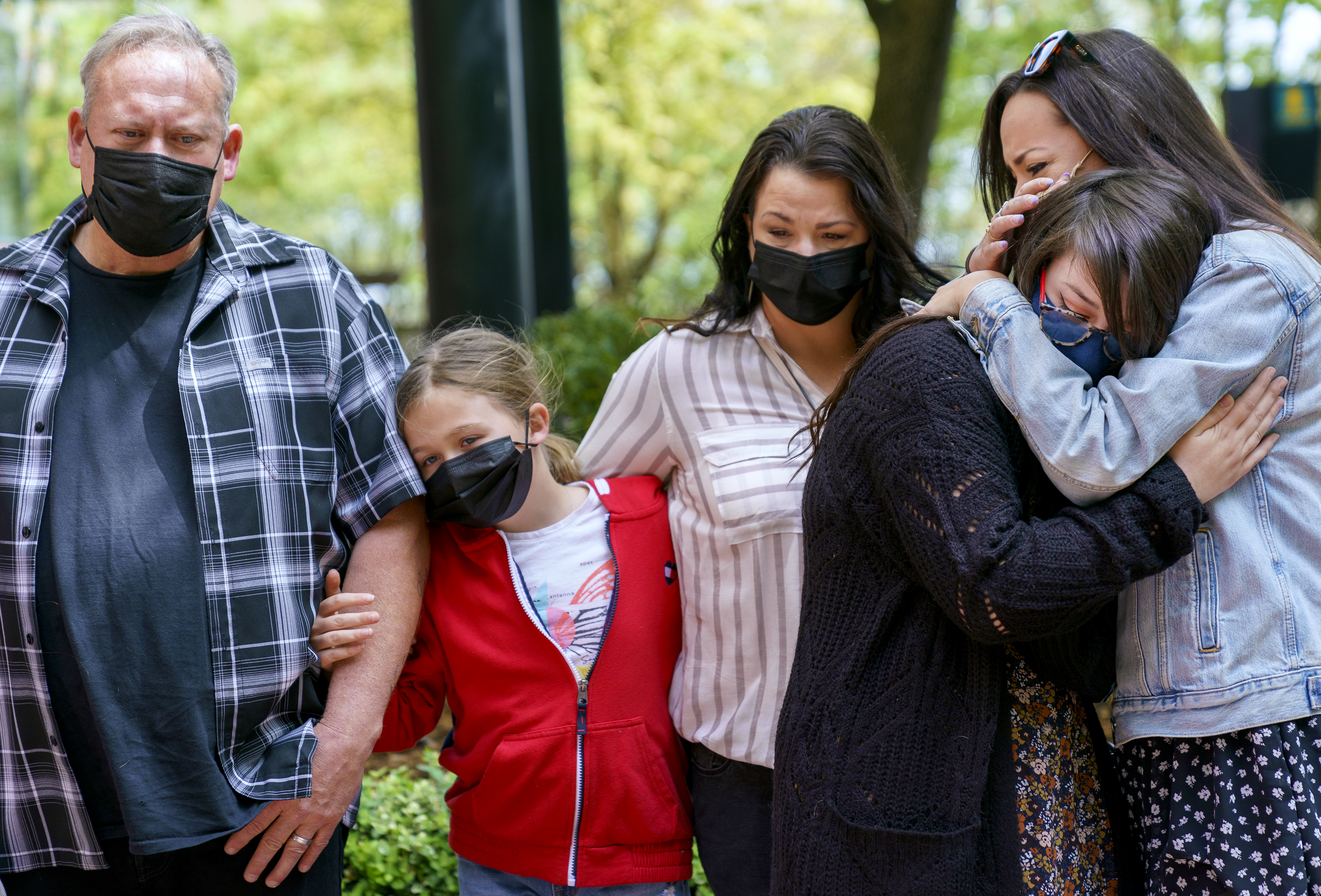 (Left to right) Family members of Robert Delgado, his brother Kirkpatrick Fries, niece Savannah Dennis, 10, sister Paulette Martin, and daughters Kennedy Garrett, 24, and Madison Scott, 30, during a press conference on Friday, April 23, 2021. Delgado was killed by Portland Police in Lents Park earlier in the month.