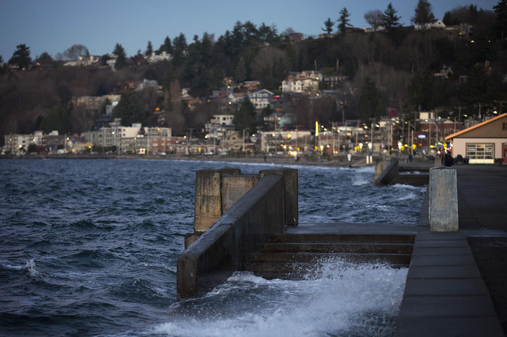 Water spills over a set of stairs that typically lead to the beach during a King Tide at Alki Beach Park on Tuesday, December 5, 2017, in West Seattle.