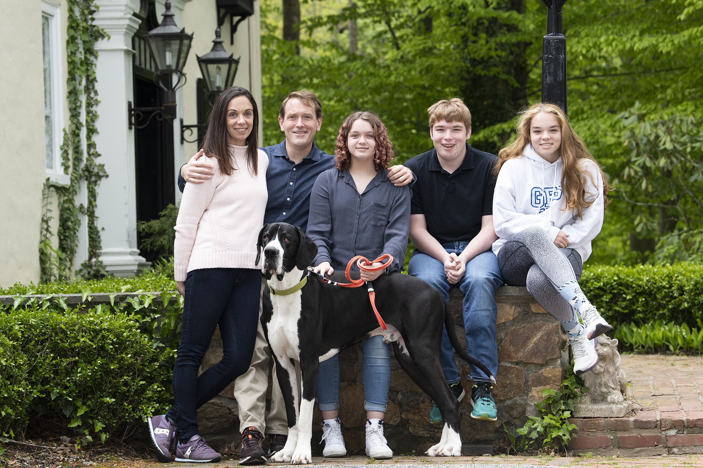 """From left, Genevieve McCormack, William McCormack, Campbell McCormack, and twins, Ted and Hadley McCormack, pose for a portrait with their dog, """"Norman,"""" at their home in Haverford."""