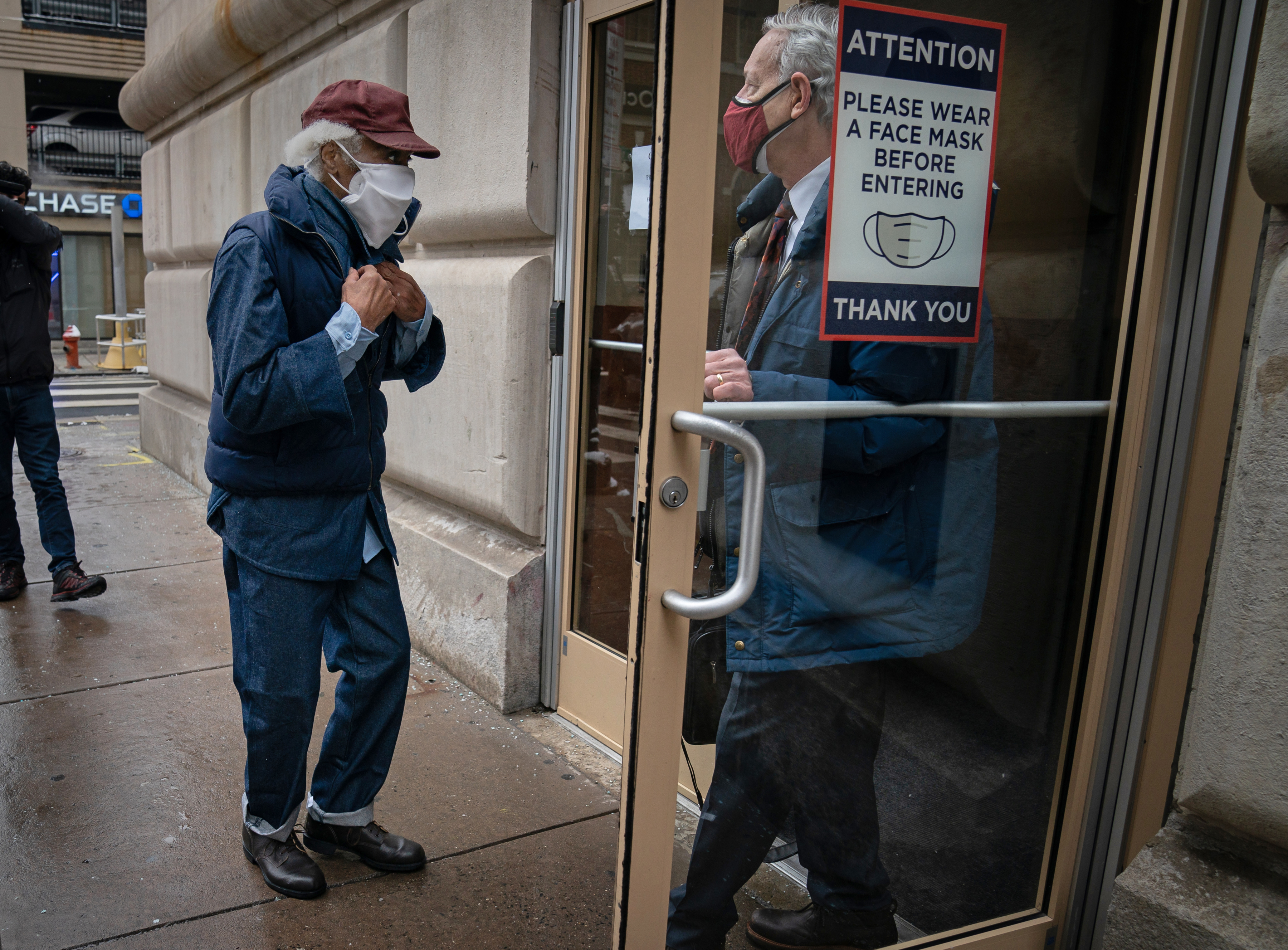 Joe Ligon, left, and his lawyer Bradley Bridge, right, arrive at Bridge's office in Center City, after Ligon was released from prison.