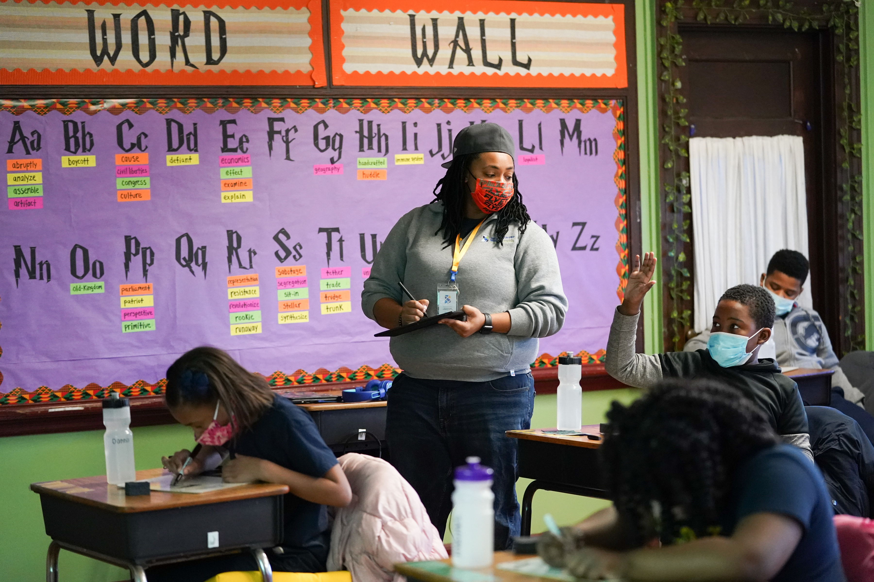 Fourth grade teacher Jacqueline Pochadt teaches a math lesson at Belmont Charter School Thursday.
