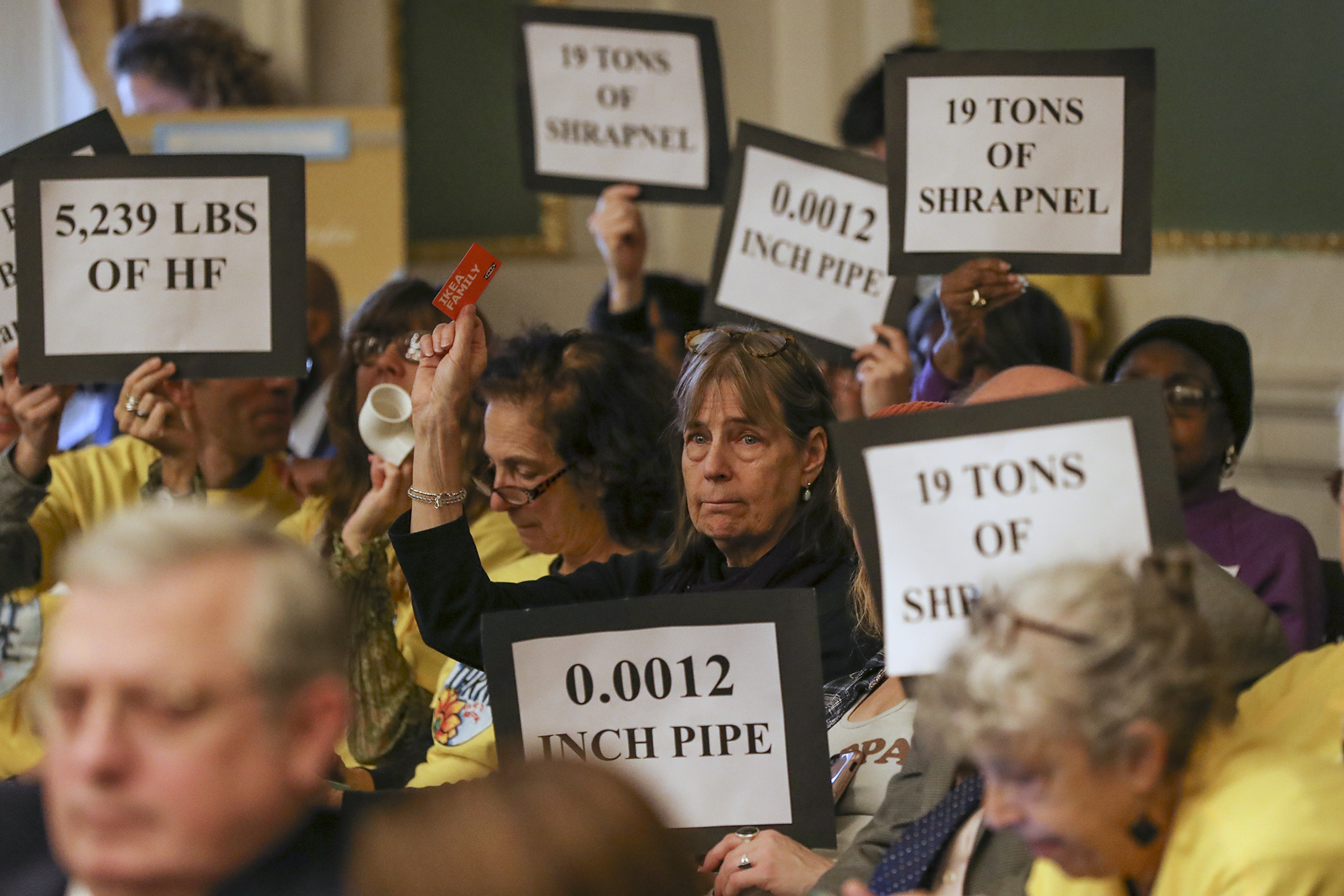 Protesters, many associated with the Philly Thrive organization, appear at a November 2019 City Council hearing about the Philadelphia Energy Solutions refinery accident.
