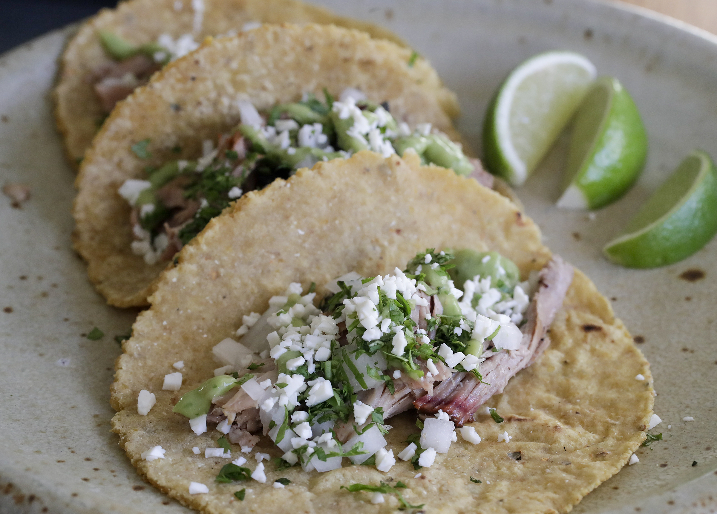 Carnitas (marinated smoked pork) taco made by Scott Hanson at Cadence Restaurant in the Fishtown section of Philadelphia on Monday, March 15, 2021. Hanson, a Texas barbecue pit master is opening a pop-up with a Tex-Mex twist at Cadence Restaurant.