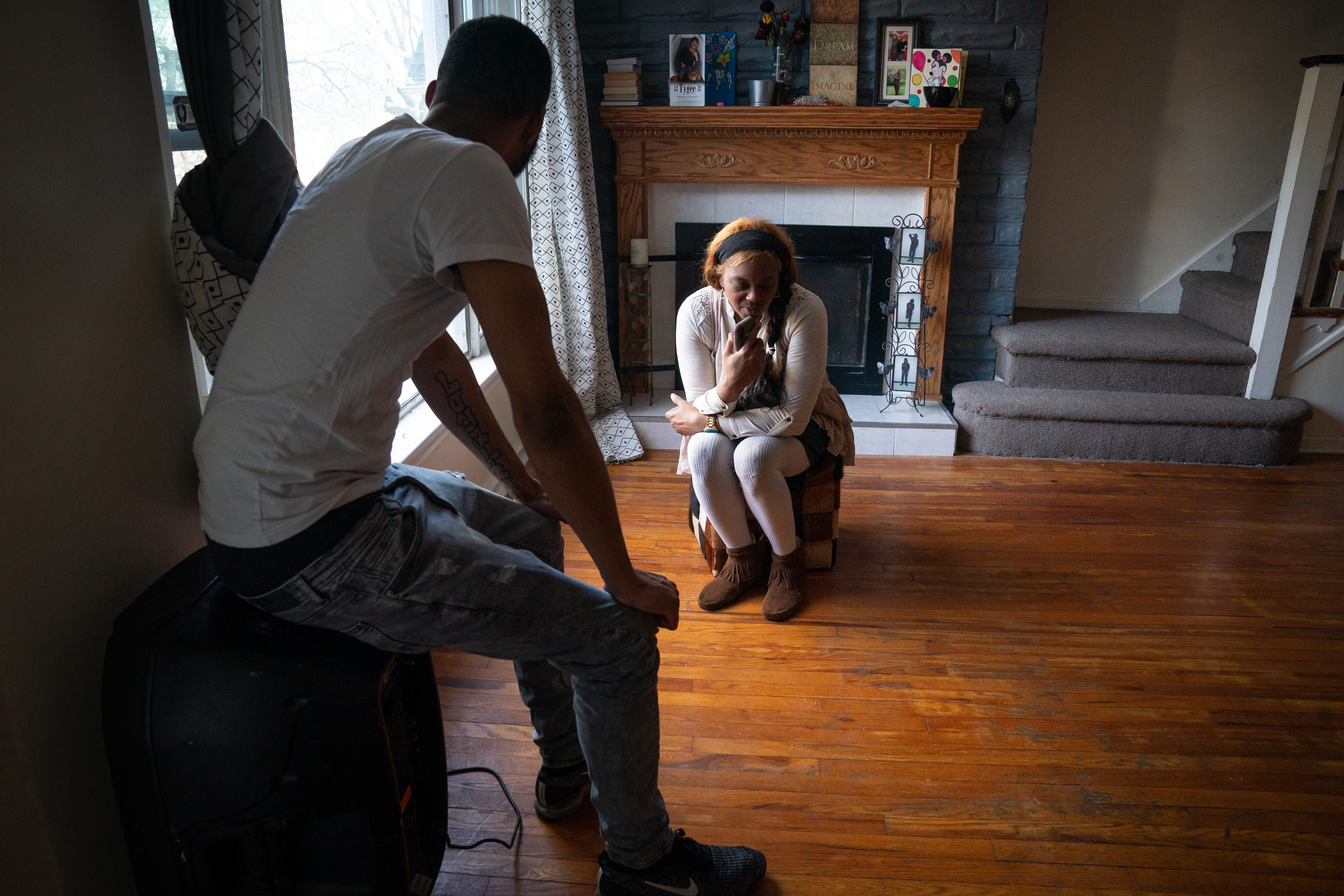 At home in Philadelphia, Marquise Spellman, (front left), and his mother Morkea Spellman, talk with India Spellman, who called home on Easter from State Correctional Institution Cambridge Springs.