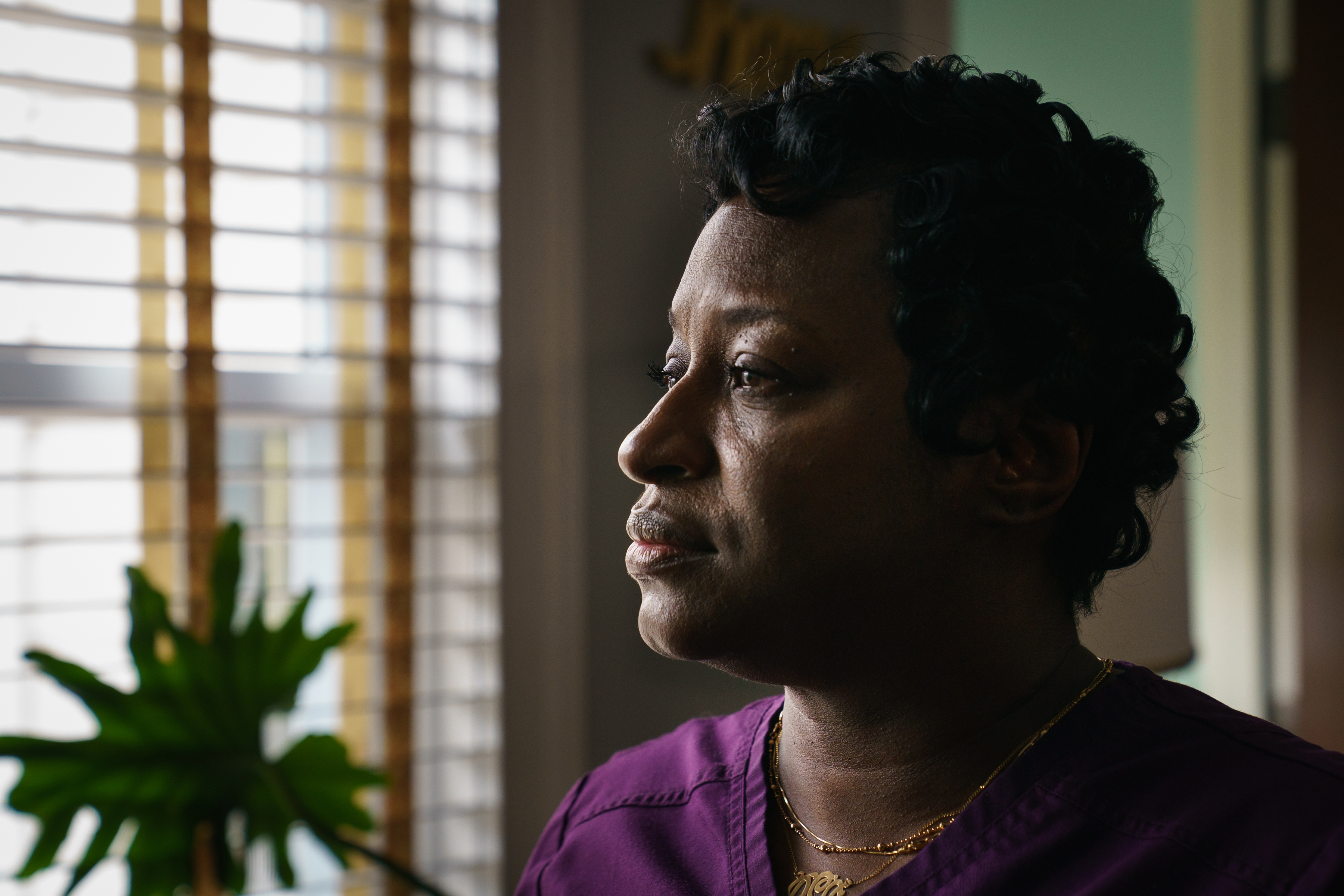 Derrell Hawkins, shown in her home in Philadelphia, said she sold her car to hire a lawyer for her son, Tyrik Perez, who maintains he's innocent of a shooting that left a man paralyzed.