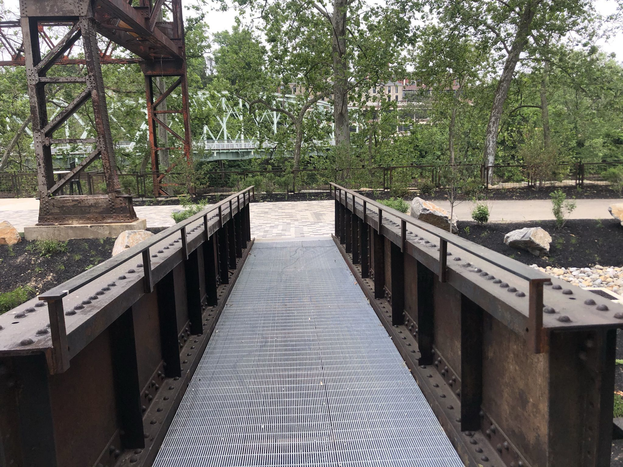Landscape architect David Rubin repurposed steel girders from the Pencoyd Iron Works to create this ramp linking the new riverwalk to the Marriott Residence Inn.