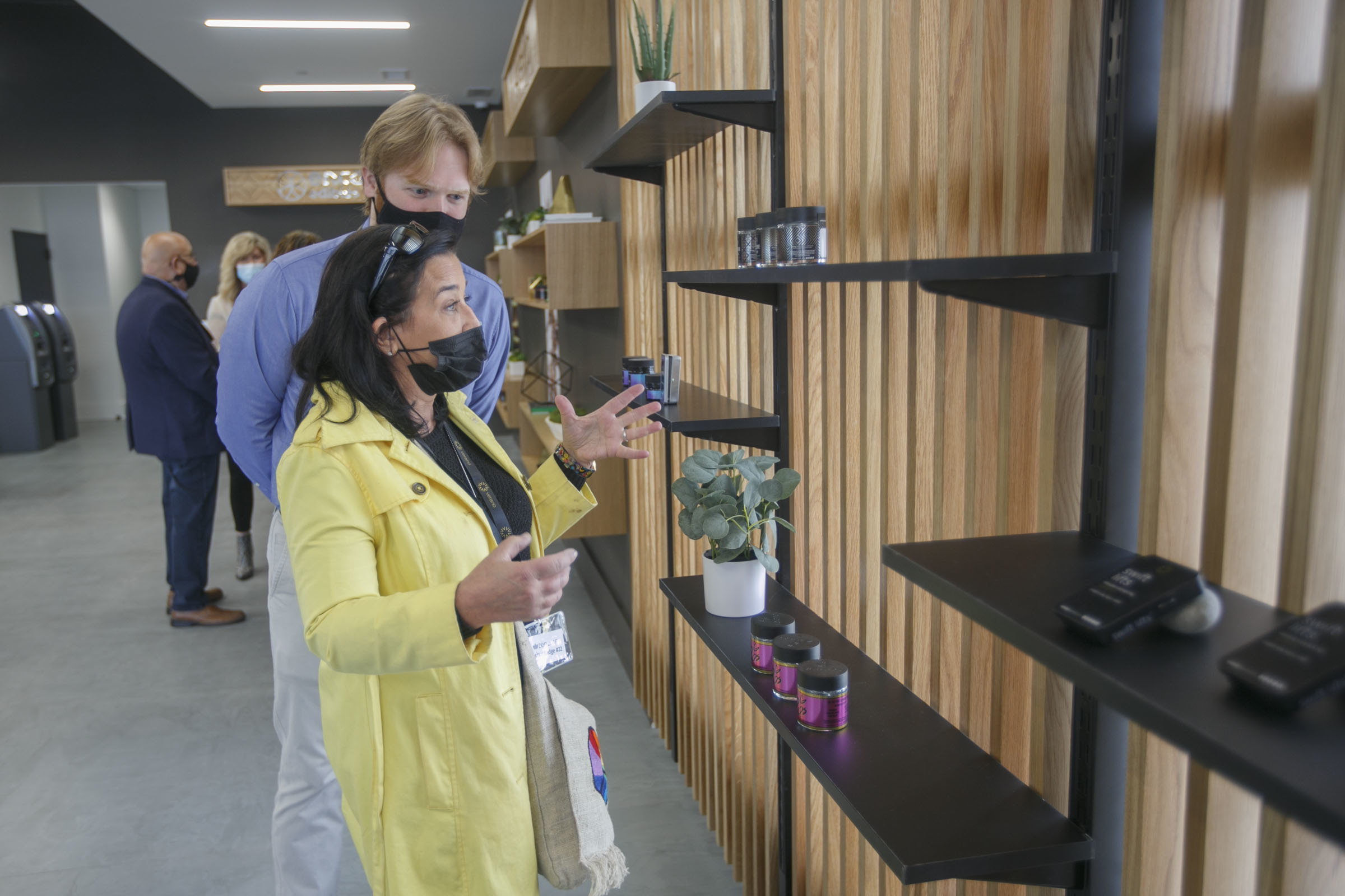 Sylvia Sylvia, (front) executive director of Asbury Park Chamber of Commerce, and Matthew C. Whelan, assistant director, tour Zen Leaf's cannabis dispensary.