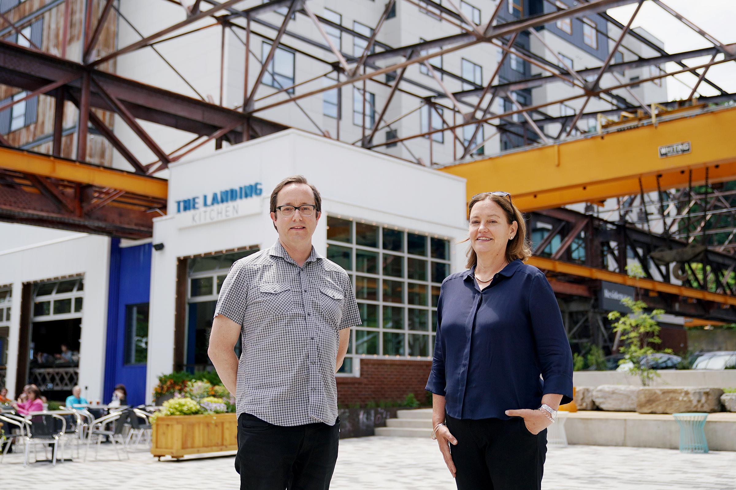 Penn Group architect Stephen Gibson (left) and co-owner Donna Galvin stand for a portrait at the Ironworks at Pencoyd Landing in Bala Cynwyd, Pa., on Wednesday, June 2, 2021. The new development, which opened earlier this year with a restaurant and hotel, is located on the site of the former Pencoyd Iron Works along the Schuylkill.