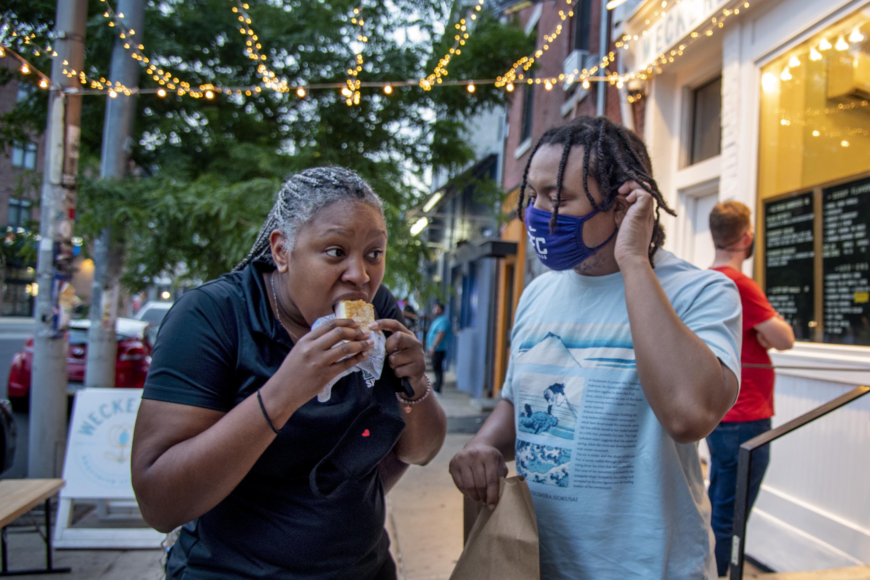Celina Smith (left) and Sharles Dent enjoy the treats at Weckerly's Ice Cream in Fishtown.