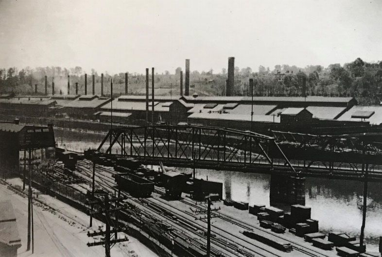 This historic photo, taken from the Manayunk side, shows a view of the Pencoyd bridge and the Pencoyd Iron Works.