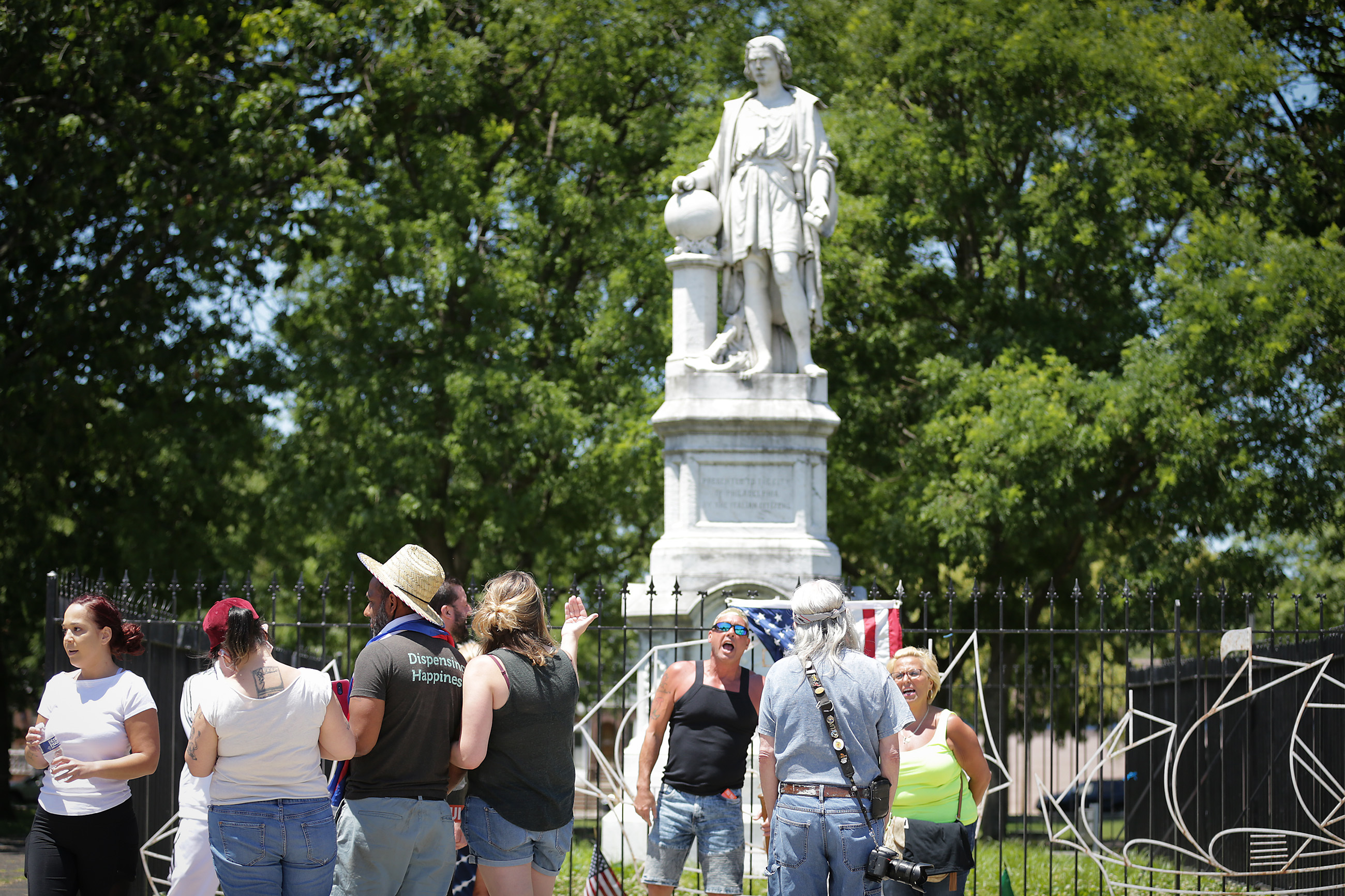 For second day, group 'protects' Christopher Columbus statue in ...