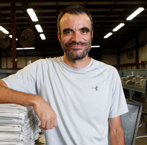 James Rakes uses his night shift paper route job to catch up on bills.