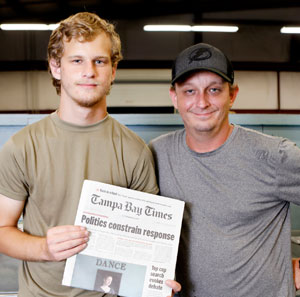 Darrin Strunk Sr. and Jr. on their Tampa Bay Times newspaper delivery job.