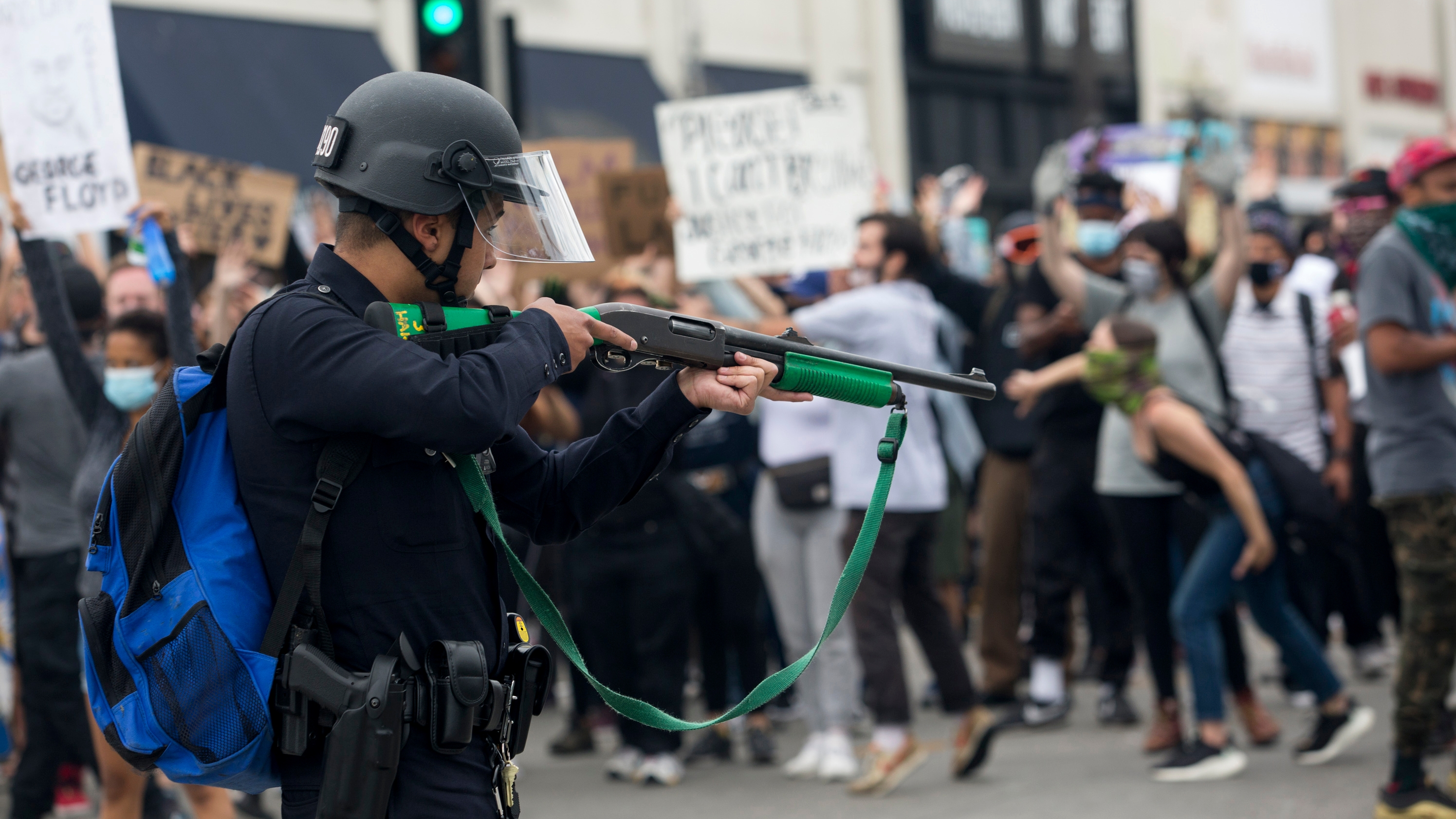 A Los Angeles police officer prepares to fire rubber bullets on Saturday, May 30, 2020, during a protest over the death of George Floyd, who died while handcuffed in police custody in Minneapolis on Monday, May 25. [RINGO H.W. CHIU | AP]