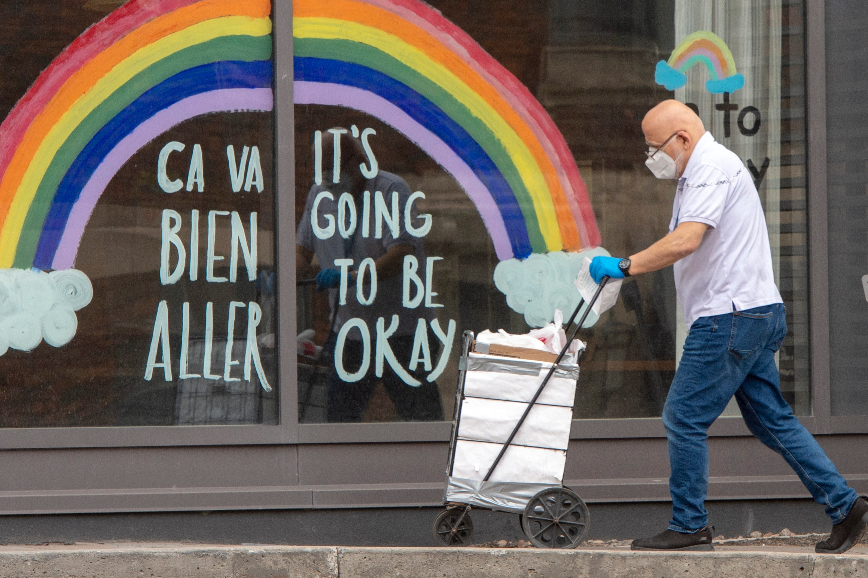 A window mural at a Montreal seniors residence reads 'it's going to be okay' in French and English.